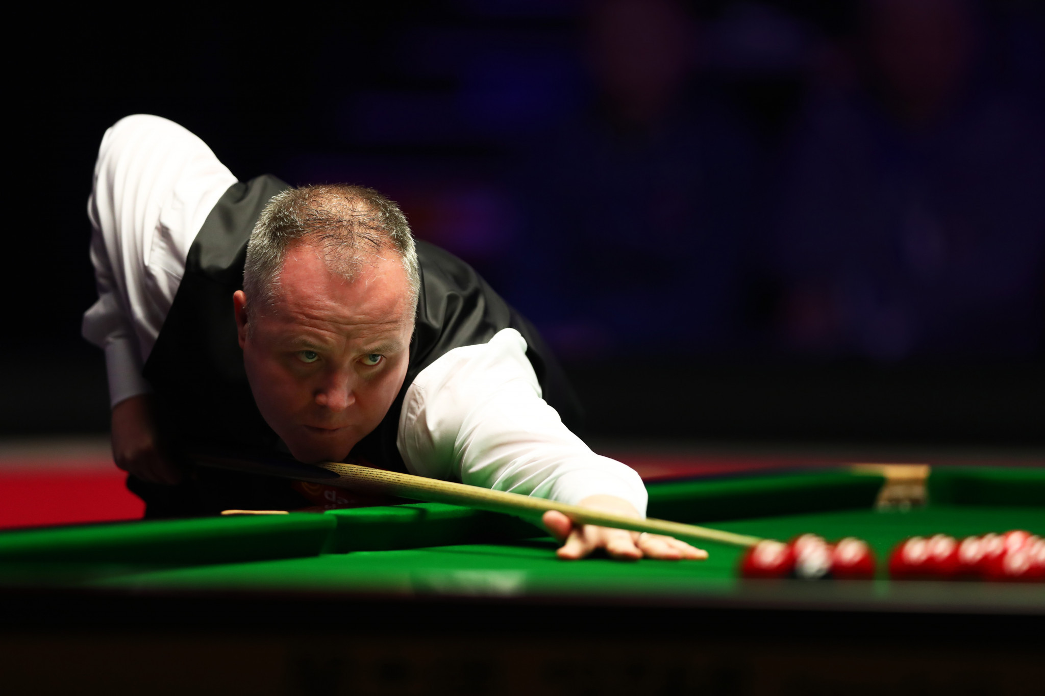 Four-time champion John Higgins is through to the second round ©Getty Images