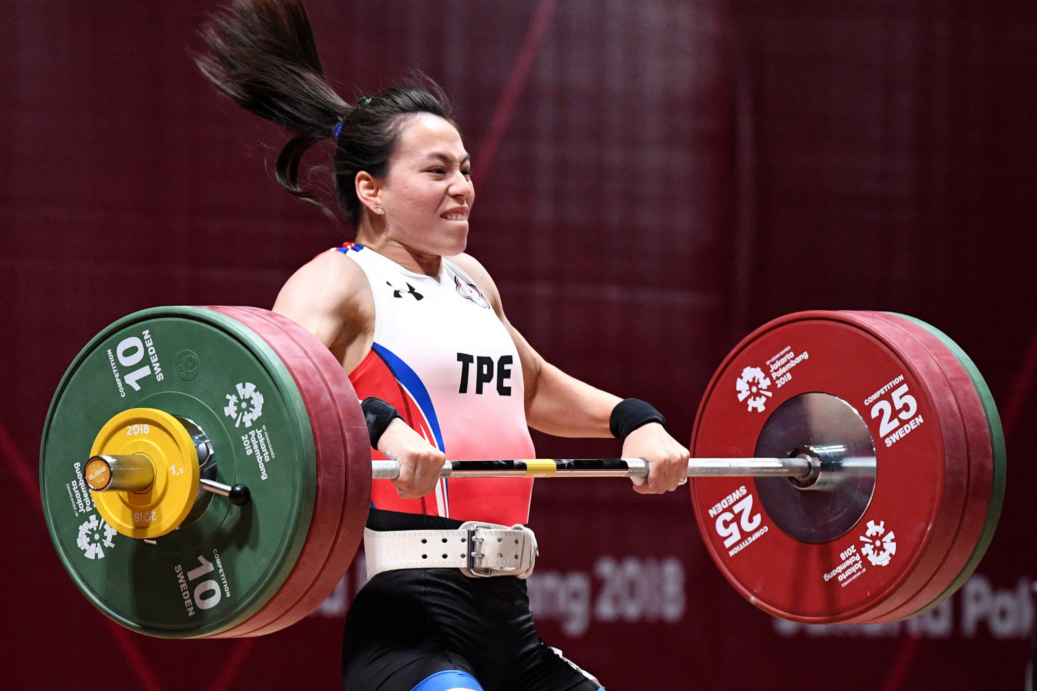 Chinese Taipei's Kuo Hsing-chun broke three world records en route to claiming the women's 59 kilograms title at the Asian Weightlifting Championships in Ningbo in China today ©Getty Images