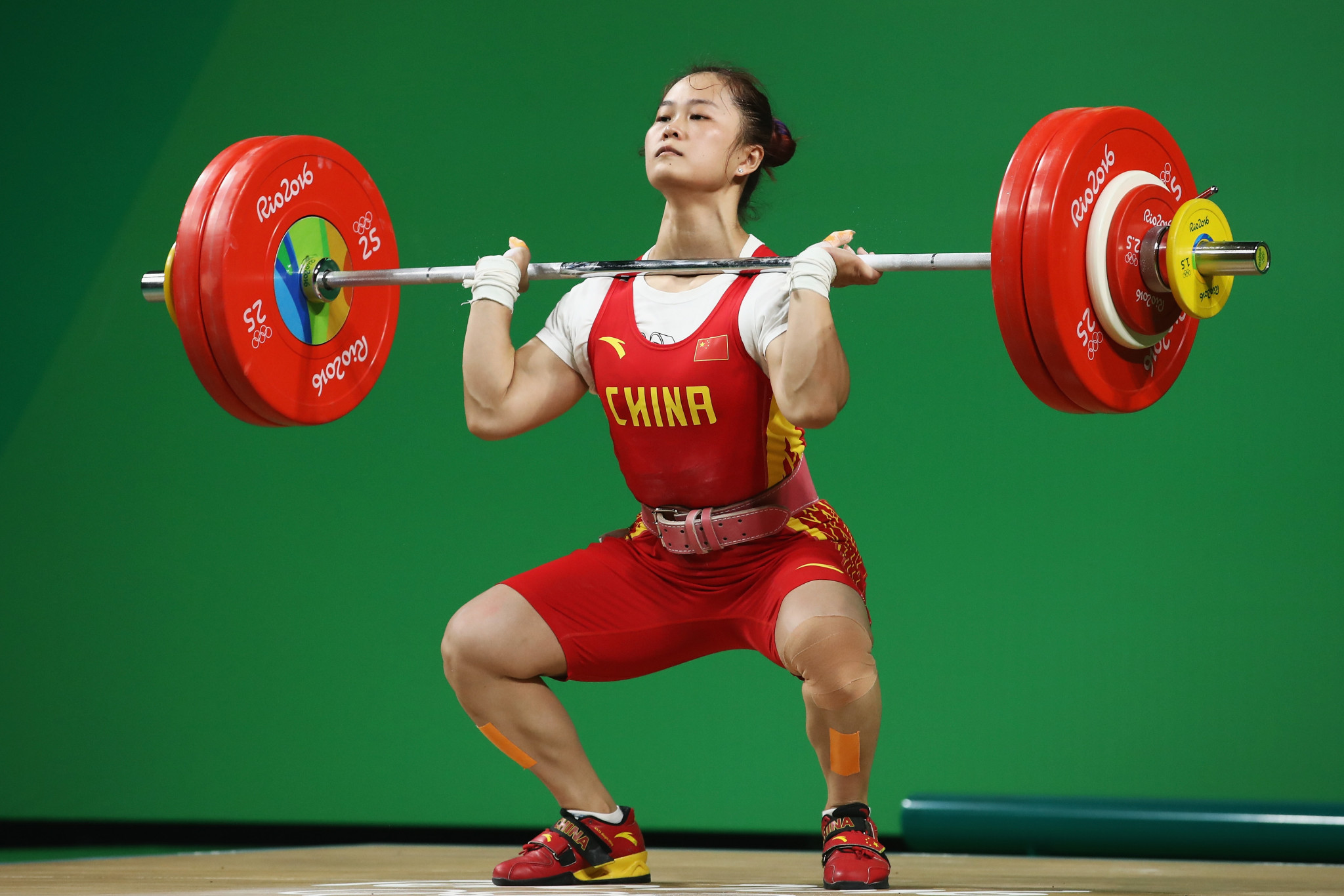 China's Deng Wei broke her world records in the snatch, clean and jerk and total to cruise to victory in the women's 64 kilograms category at the Asian Weightlifting Championships in Ningbo in China today ©Getty Images