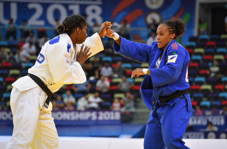 Morocco's Rio 2016 Olympian Assmaa Niang, right, will defend her African Senior women's under-70kg title in South Africa ©Getty Images