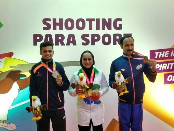 India's 17-year-old Manish Narwal, left, wants to hold junior and senior world records by next year, when he hopes to challenge for a shooting medal at the Tokyo 2020 Paralympics