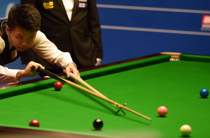 China's world number 35 Zhou Yuelong earned a shock win over world number six Mark Allen in the first round of the World Snooker Championships in Sheffield ©Getty Images