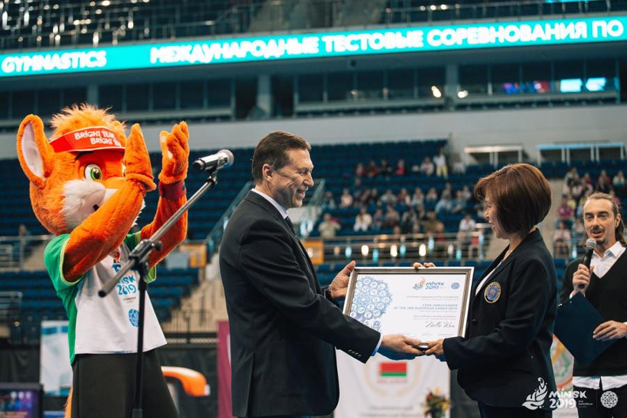 George Katulin, the chief executive of Minsk 2019, presented Nellie Kim with a certificate to mark her appointment as a star ambassador for the European Games ©Minsk 2019