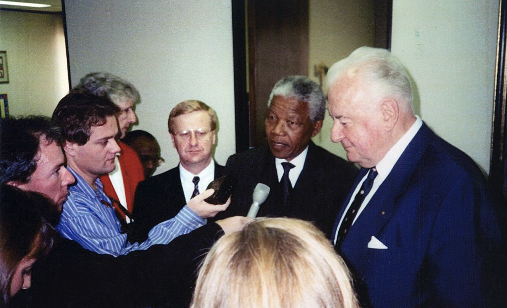 John Coates, seen here with Nelson Mandela, said a possible Brisbane/South-east Queensland bid for the 2032 Olympic and Paralympic Games was