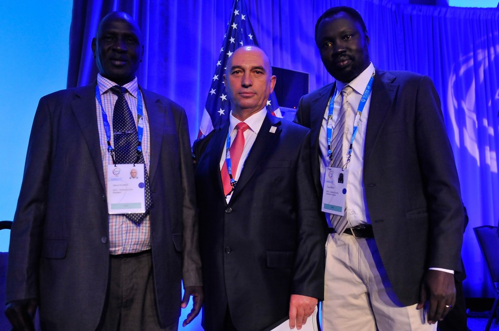 KOC President Besim Hasani, pictured (centre) following Kosovo and South Sudan's recognition by ANOC yesterday ©Getty Images
