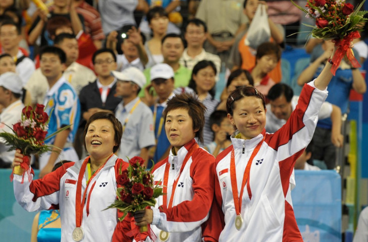 Singapore's Wang Yuegu (left), Feng Tianwei (centre) and Li Jiawei (right) won the women's team silver medal at the Beijing 2008 Olympic Games