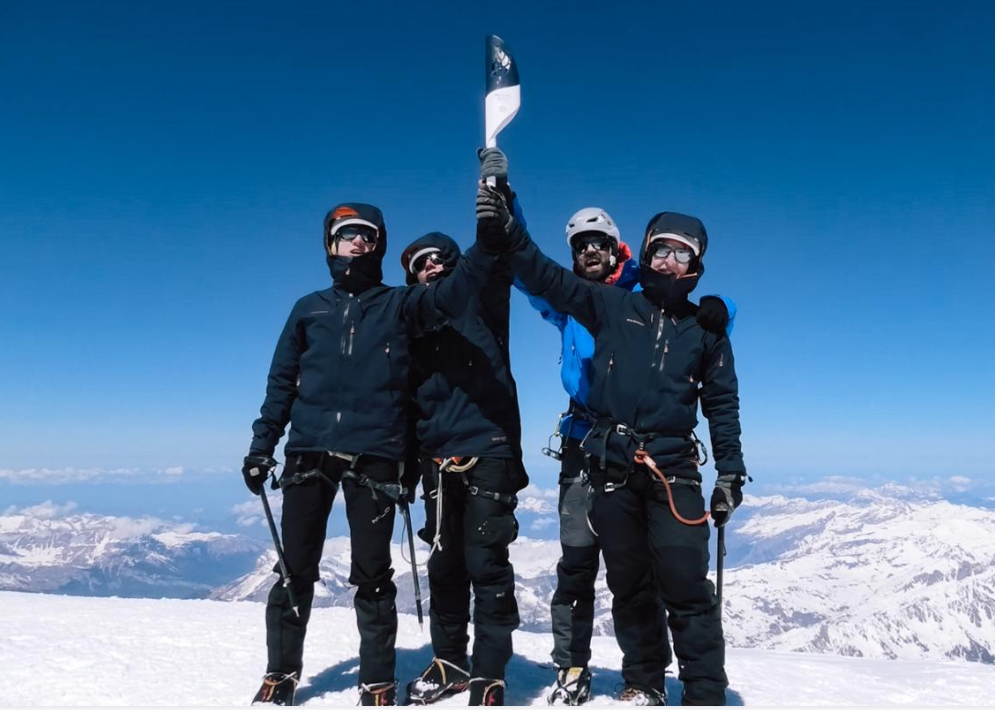 The mountaineers hold aloft the Flame at the summit of Mont Blanc ©Minsk 2019