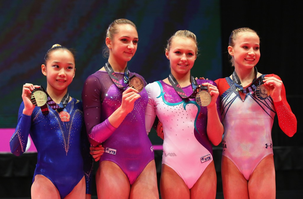 Four gymnasts won gold in the women's uneven bars event after each scored 15.366 ©Getty Images