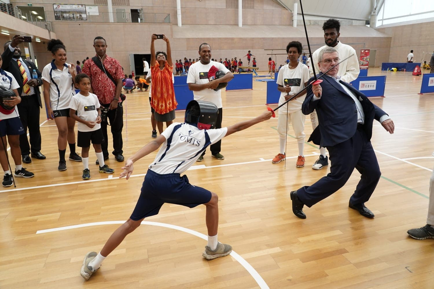 IOC President Thomas Bach visited Taurama Aquatic and Indoor Centre in Papua New Guinea, where he displayed his fencing skills ©Facebook
