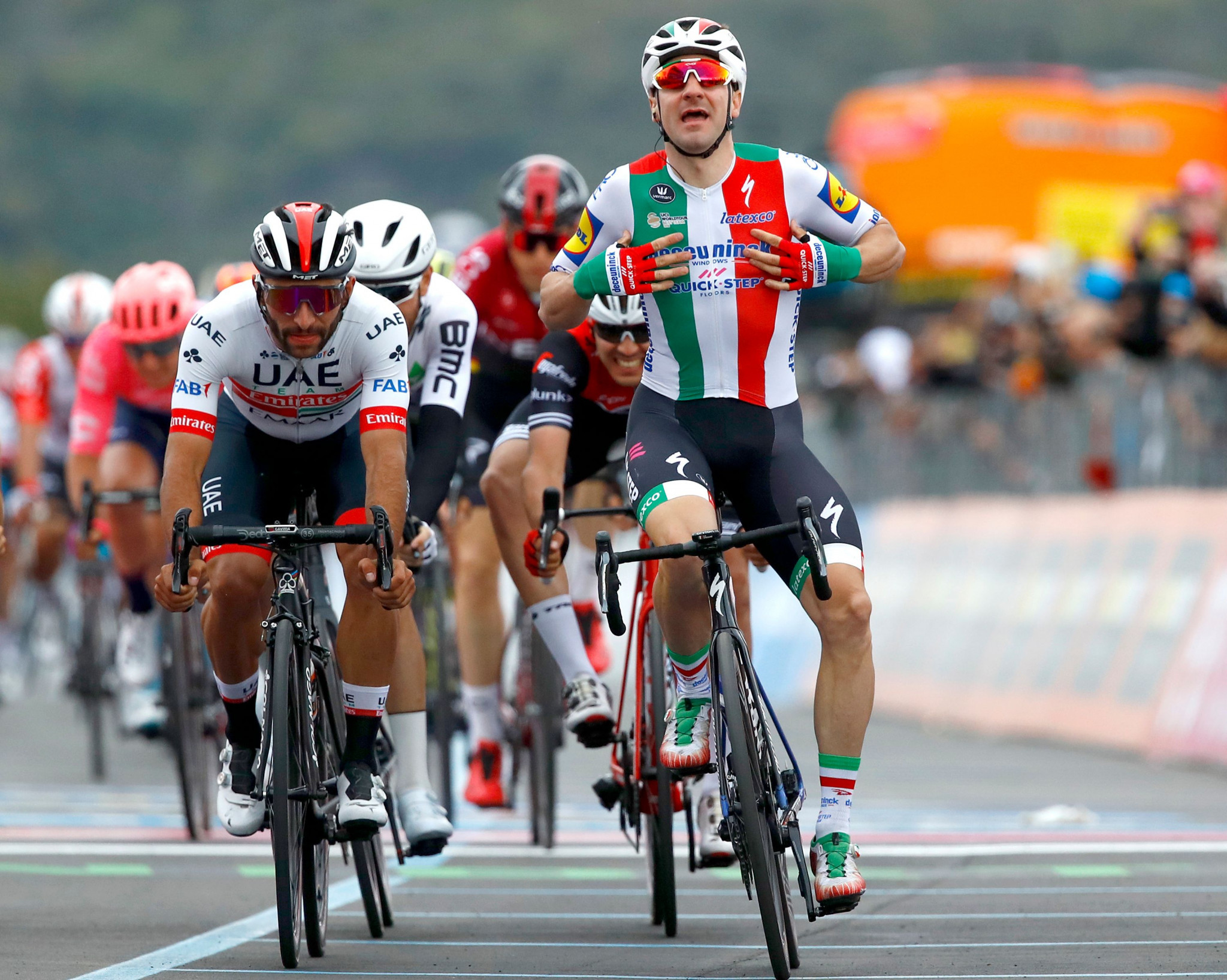 Home favourite Elia Viviani crossed the line first but was disqualified for dangerous riding ©Getty Images