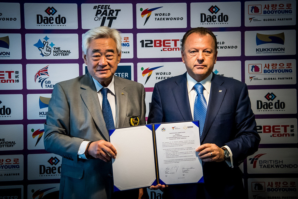 While the action was taking place, President Choue and International Judo Federation President Marius Vizer signed a Memorandum of Understanding ©World Taekwondo