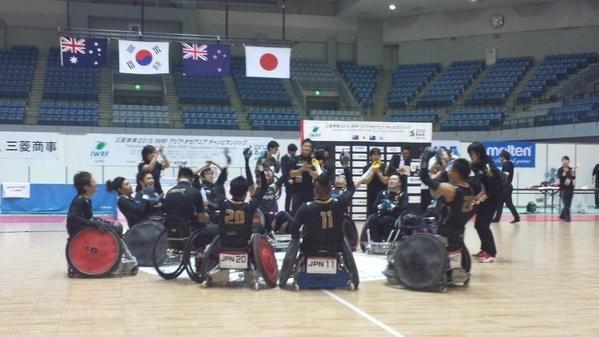 Japan celebrate winning the IWRF Asia-Oceania title