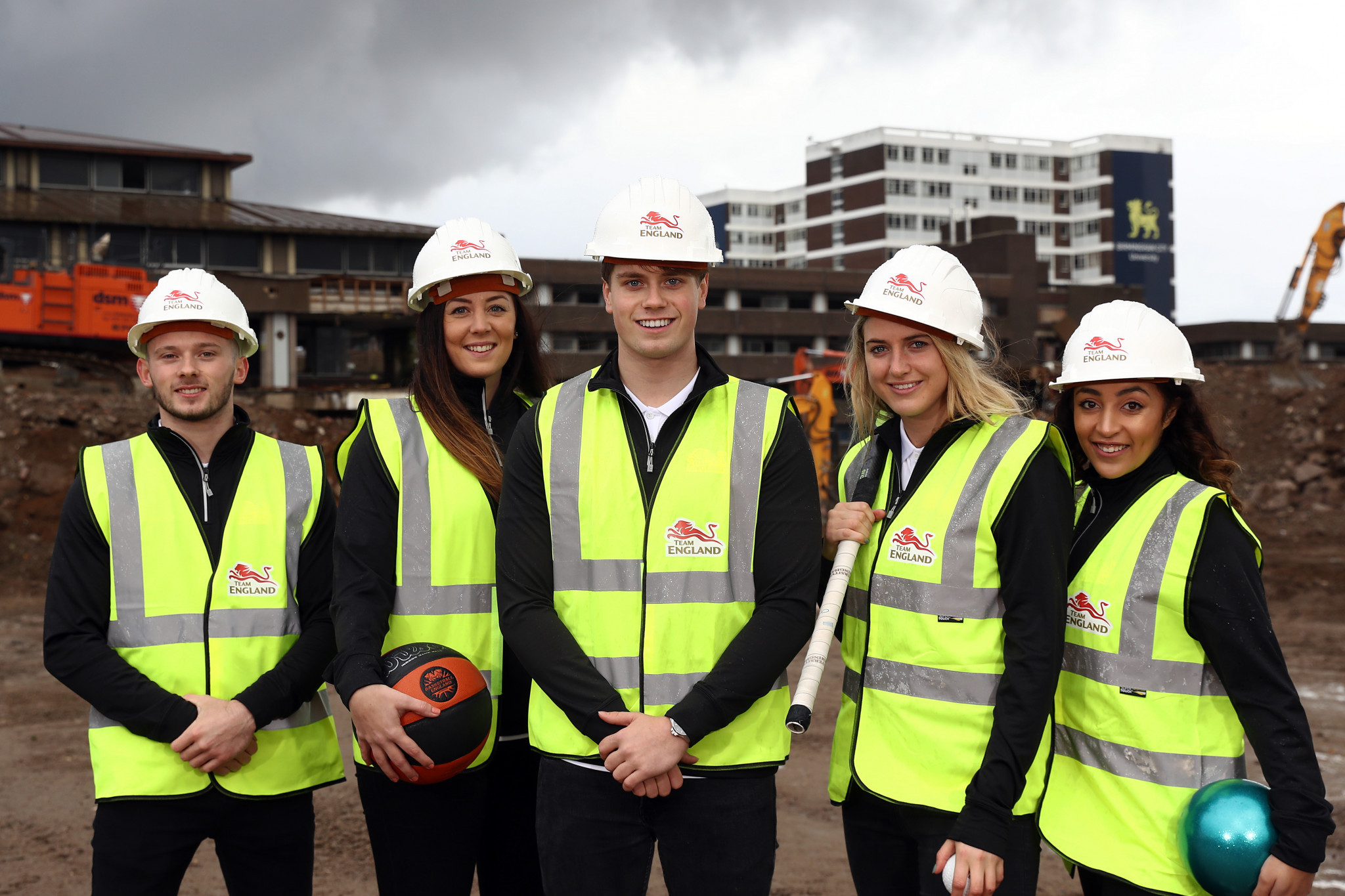 Team England athletes Dominick Cunningham (gymnast), Siobhan Prior (basketball) Tom Hamer (swimmer), Lily Owsley (hockey) and Mimi Cesar (gymnast) at the proposed site for the 2022 Commonwealth Games Athletes' Village ©Getty Images