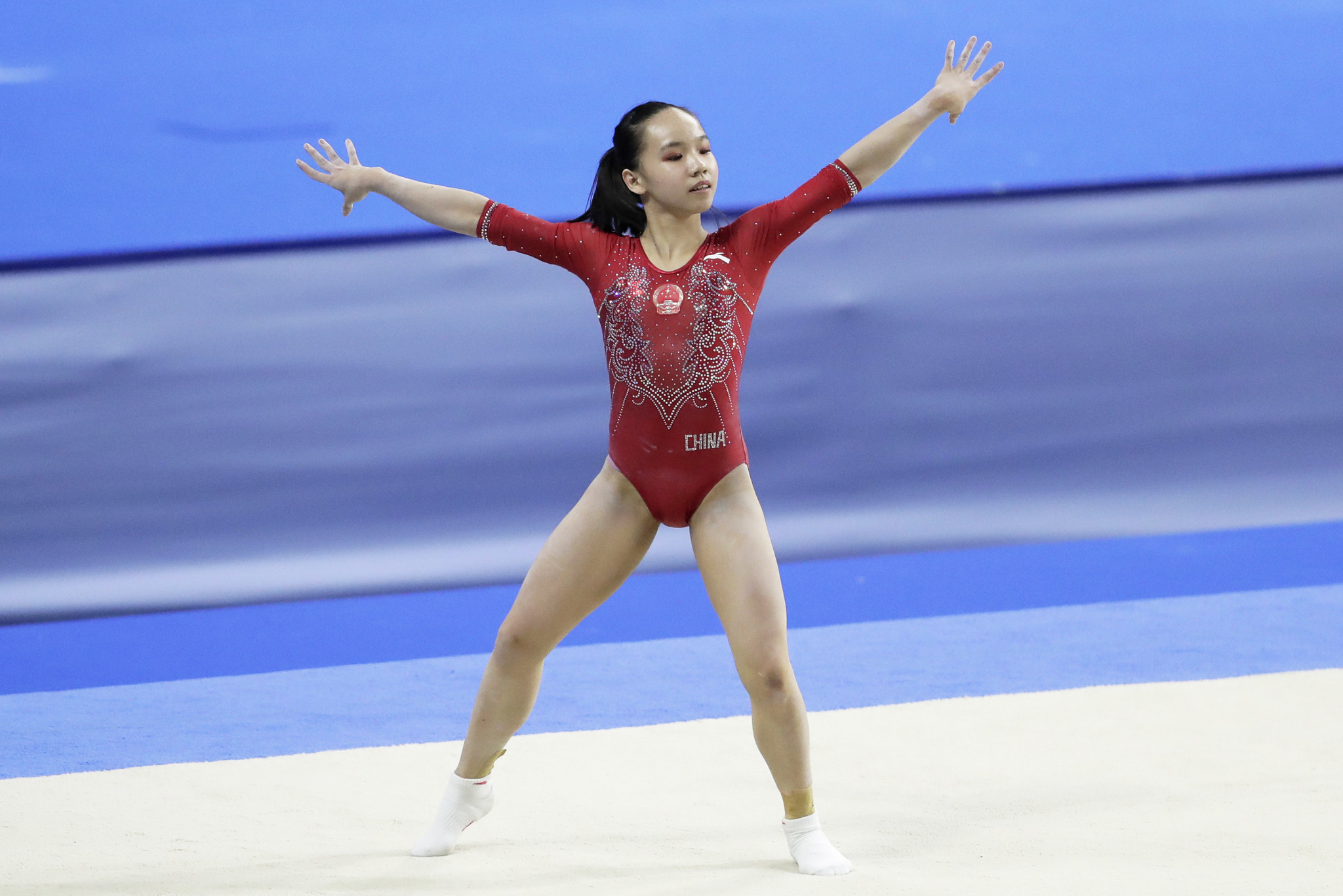 China's Liu Jingxing added the women's floor exercise gold medal to her uneven bars silver won yesterday ©Getty Images