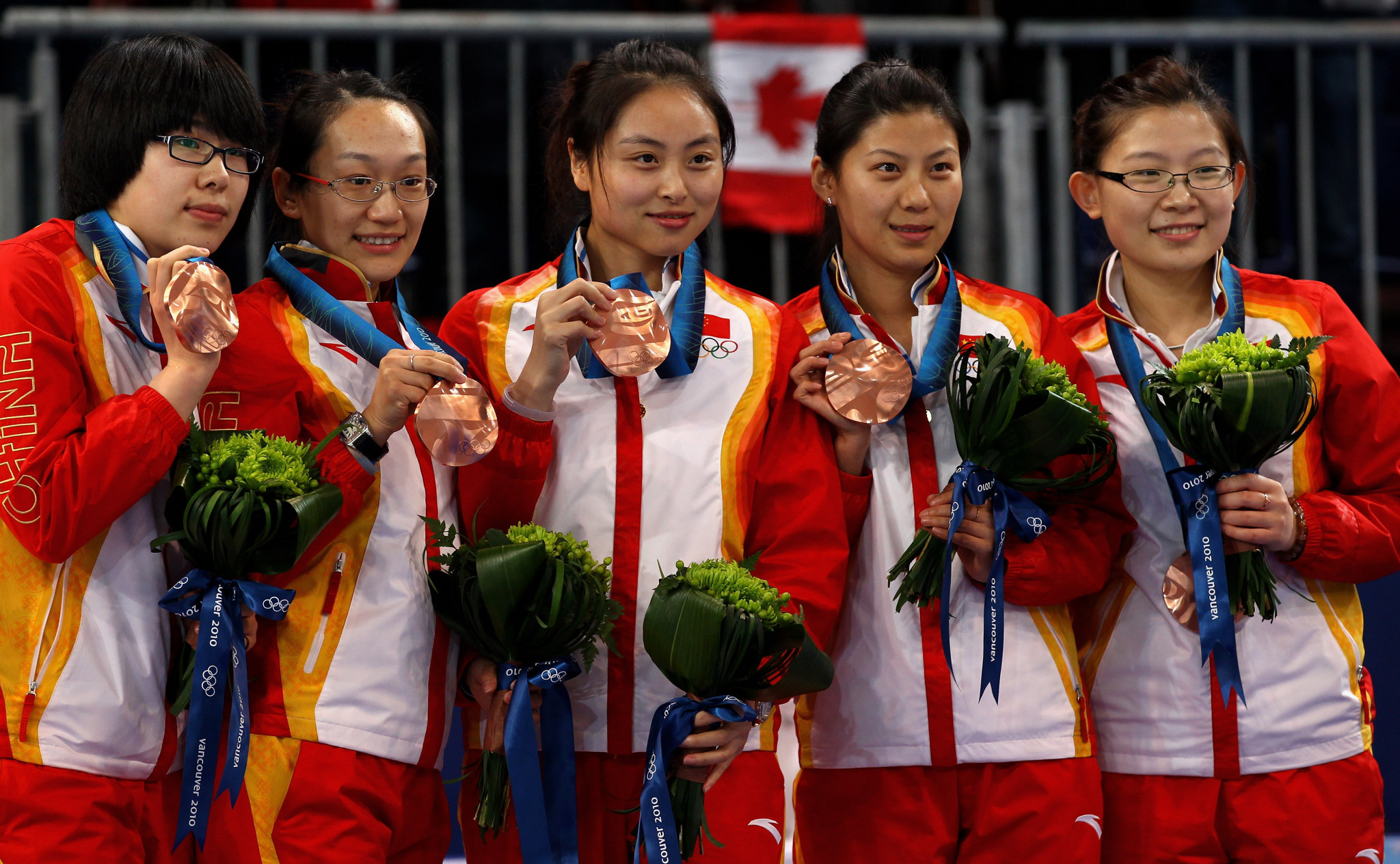 Wang Bingyu, far right, led China to an Olympic bronze medal at Vancouver 2010 ©Getty Images