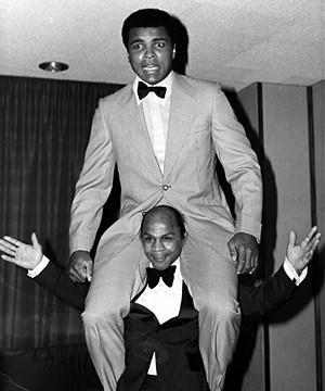 Precious McKenzie balances boxing great Muhammad Ali on his shoulders ©Precious McKenzie