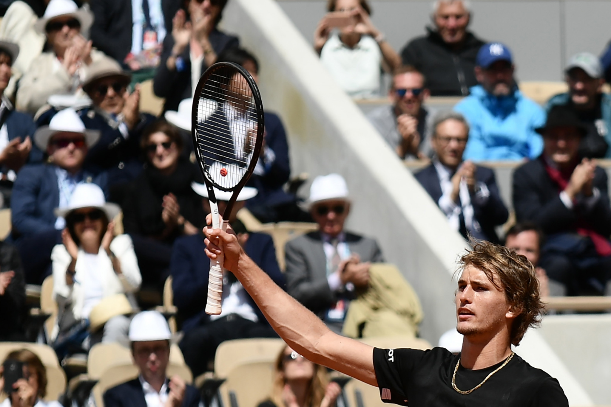Zverev battles through frustration to reach second round  at French Open