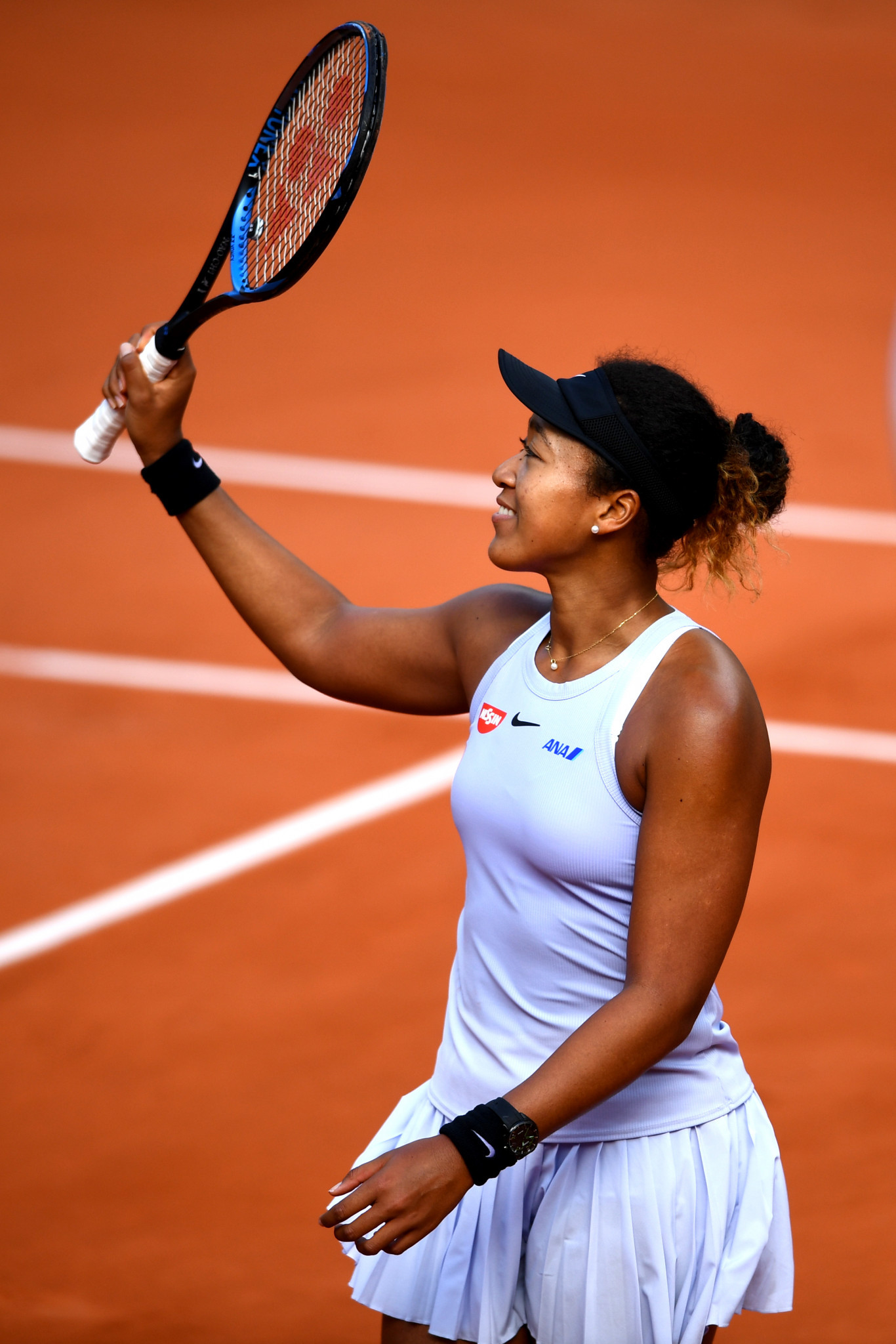 Osaka and Halep dig deep to progress at French Open
