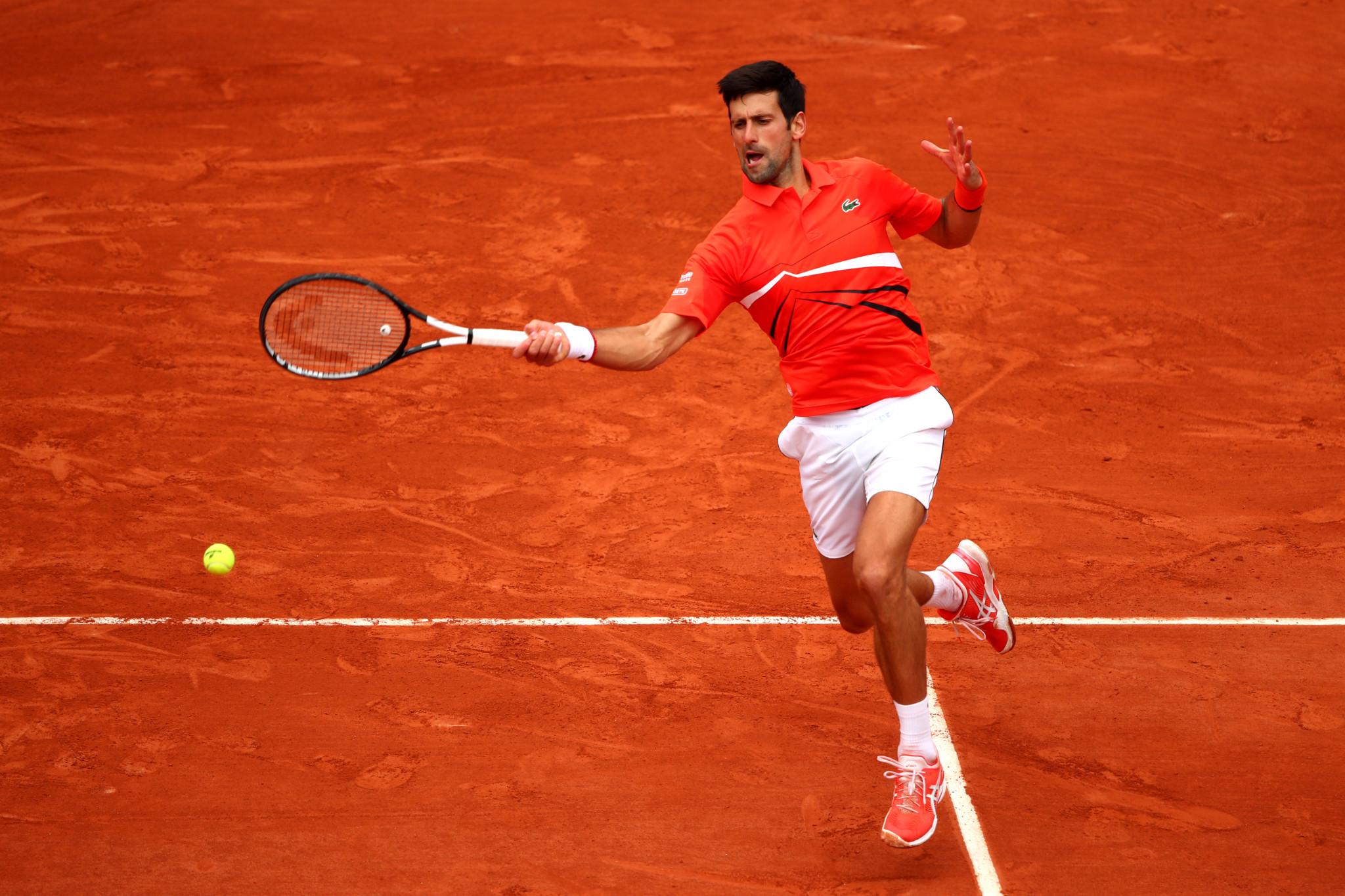 Djokovic eases into round three as women's seeds tumble at Roland-Garros