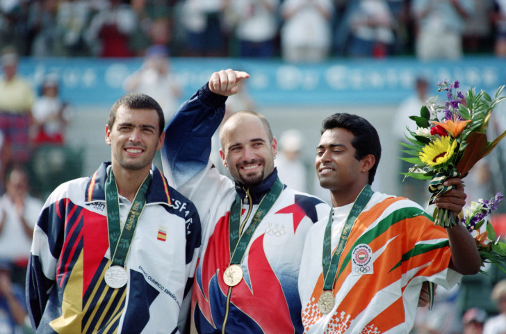Leander Paes, pictured, right, with the bronze medal from the 1996 Atlanta Games – alongside silver medallist Sergi Bruguera of Spain and winner Andre Agassi of the United States – plans to extend his record run of Olympic tennis appearances by competing in an eighth Games in Tokyo next year ©Getty Images