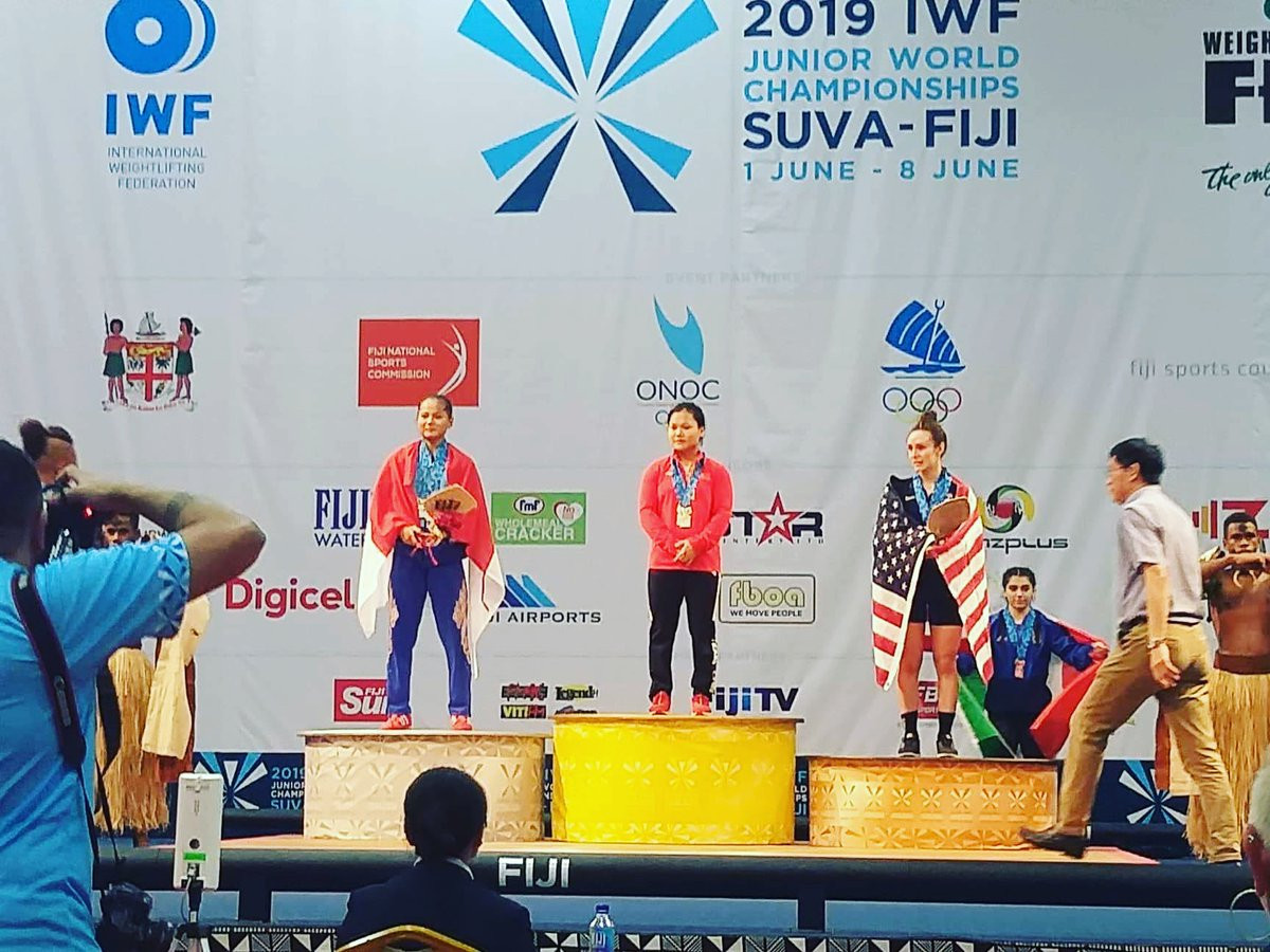 China's Jinhong Zhao, centre, returned from a three-year international absence to win the gold medal in the 49kg category at the IWF Junior World Championships ©Twitter