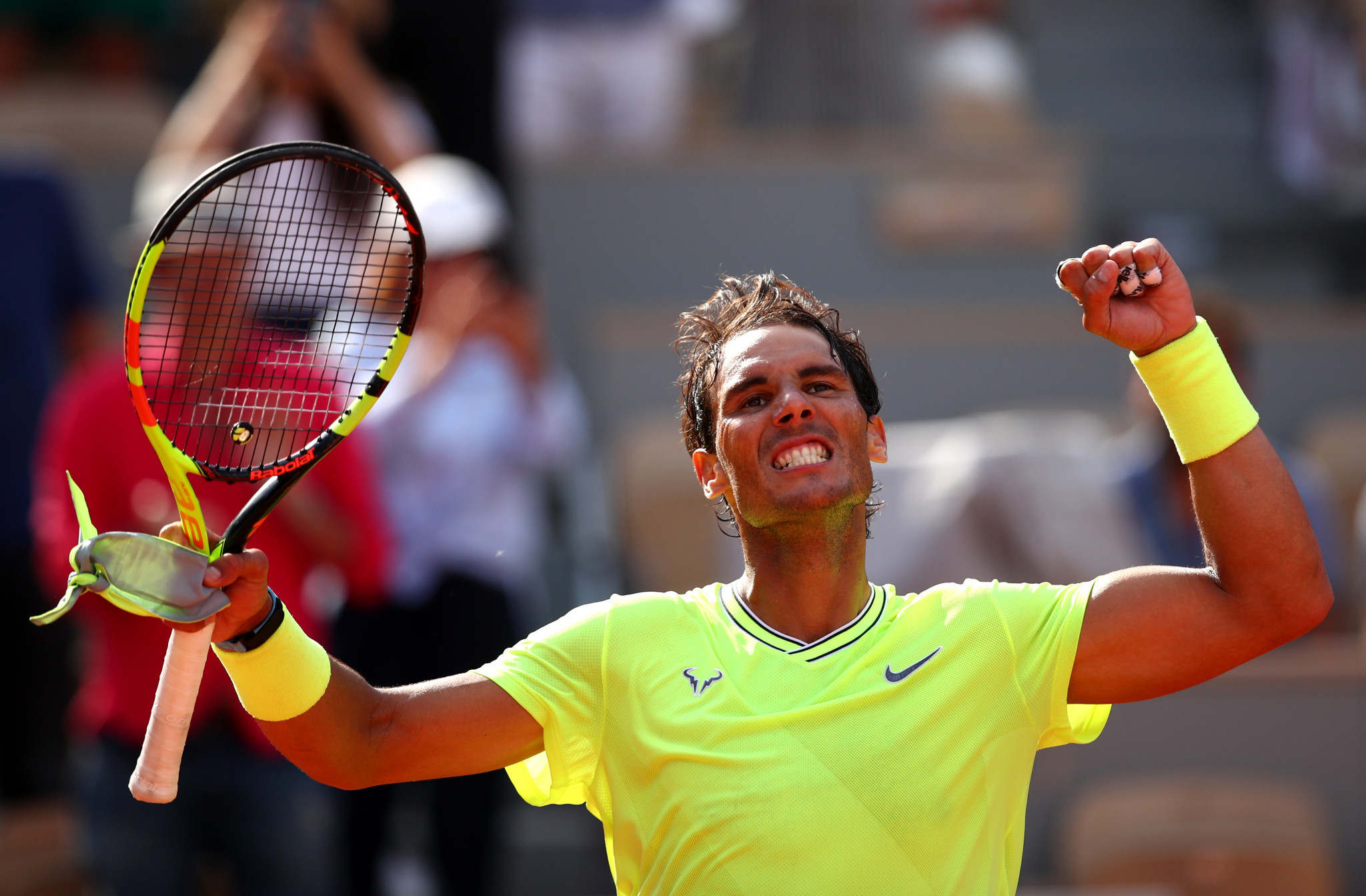 Smiles all round for Spaniard Nadal as he cruises into French Open last eight