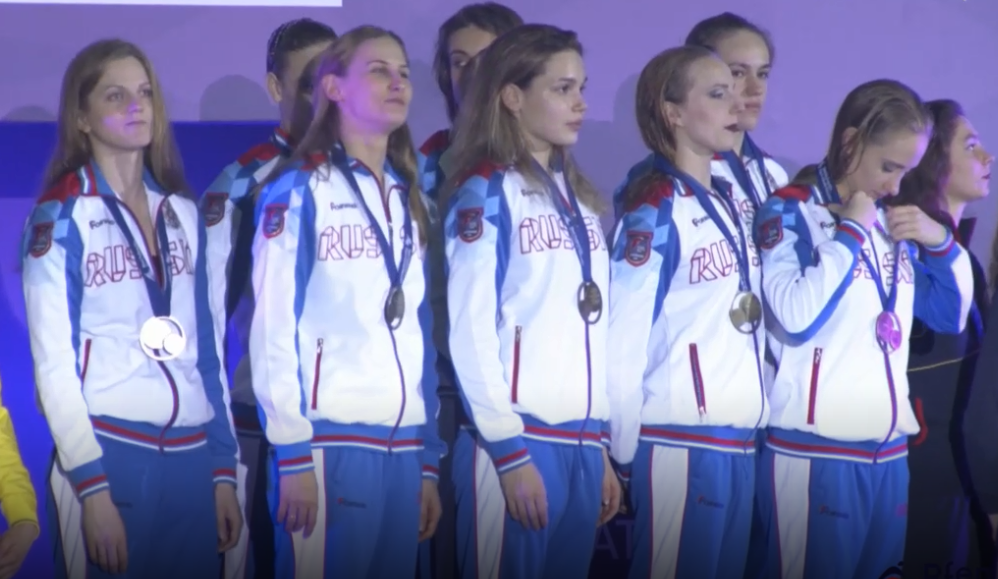 Russia collect their team free medals ©FINA