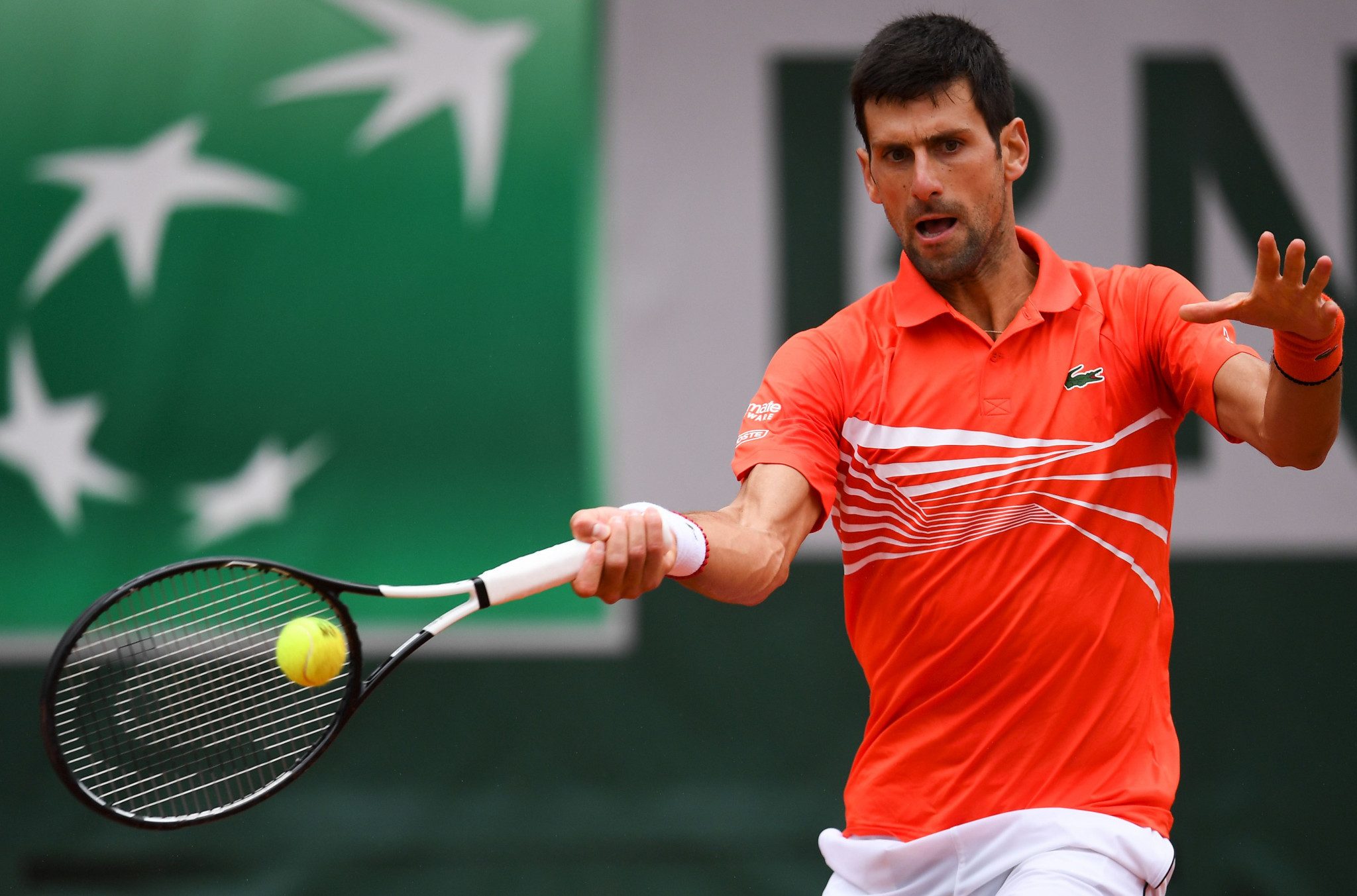 Djokovic and Halep among big guns safely through to French Open quarter finals