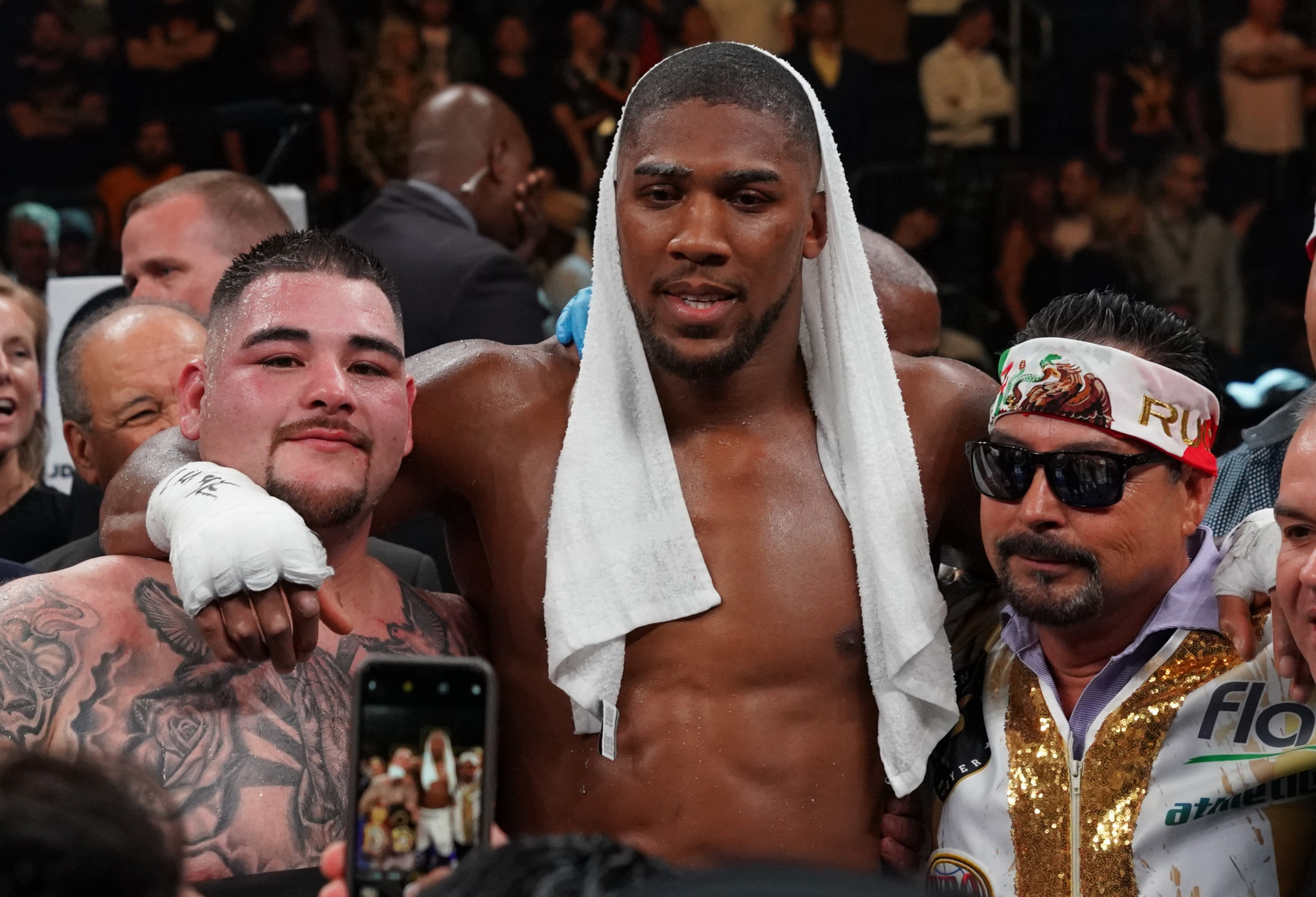 Rather than appearing upset by his shock defeat, Anthony Joshua happily posed with pictures with the man who beat him - Mexico's unfancied Andy Ruiz jnr ©Getty Images