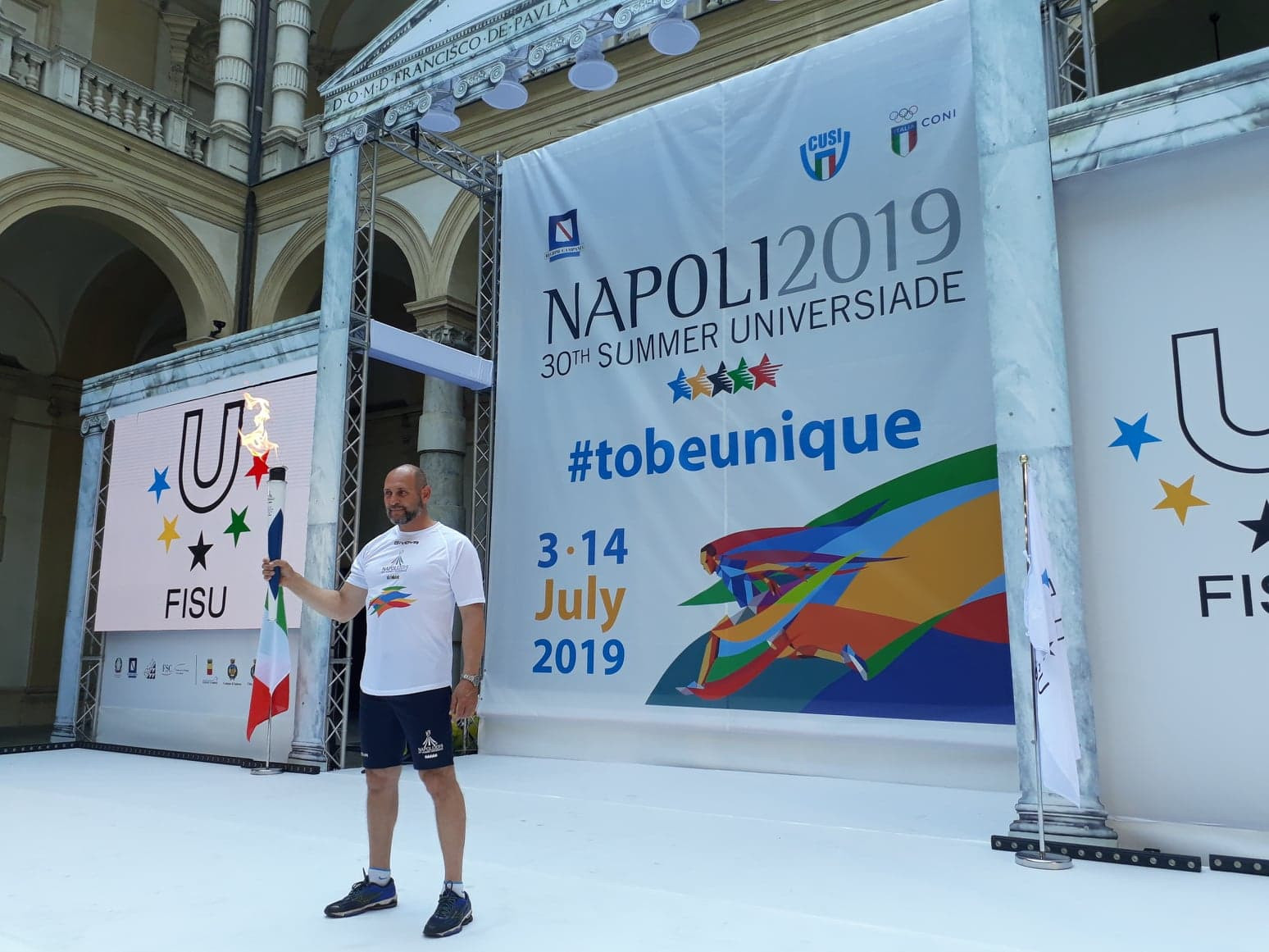 Italian double Olympic rowing champion Davide Tizzano began the Torch Relay for the Naples 2019 Summer Universiade ©ITG