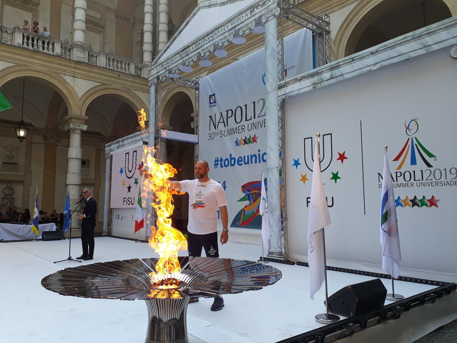 Tizzano became the first Torchbearer, leaving the University of Turin to begin the relay down Via Giuseppe Verdi ©ITG