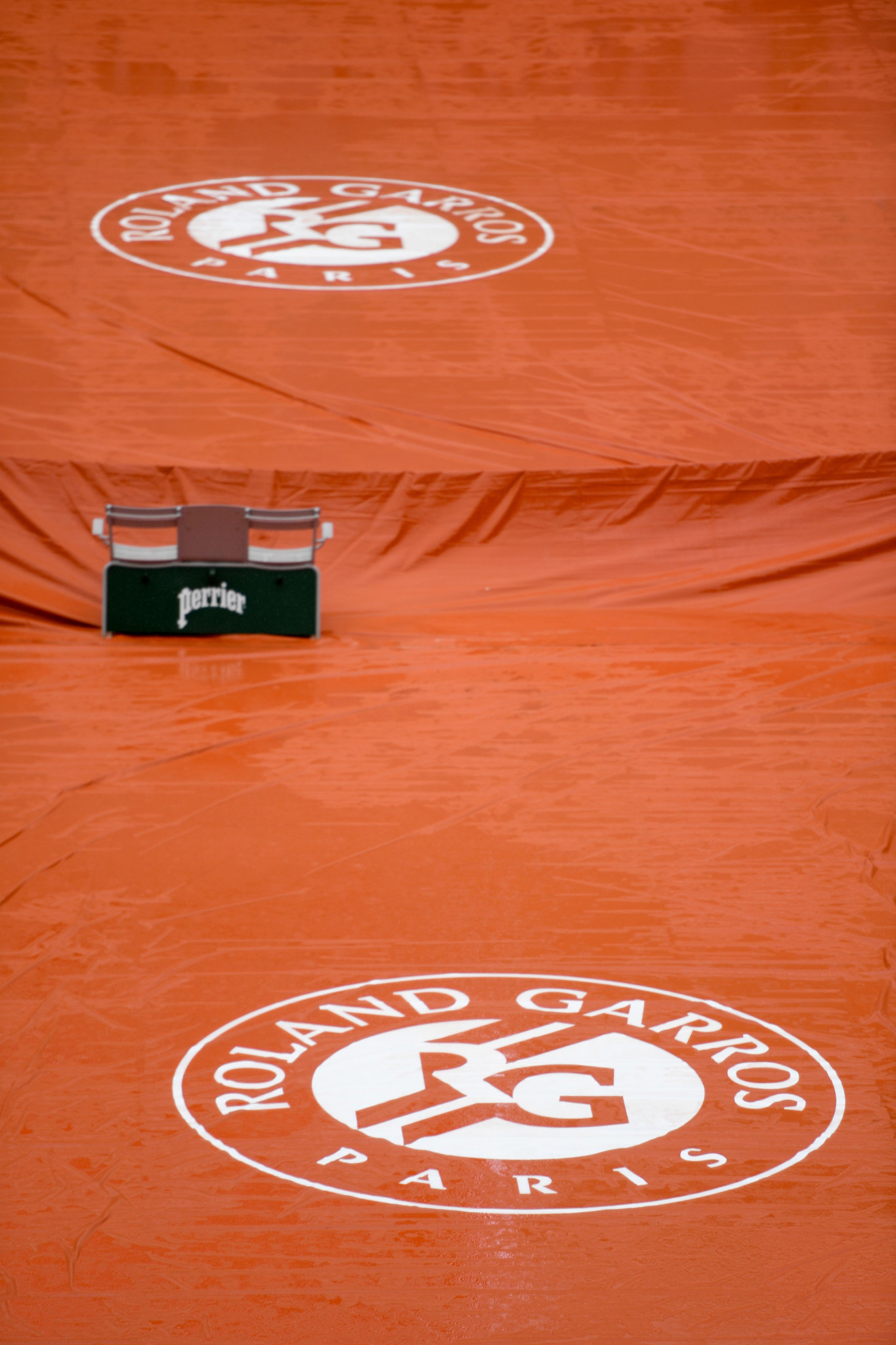 A court surface is covered as rain falls on day 11 of the French Open in Paris ©Getty Images