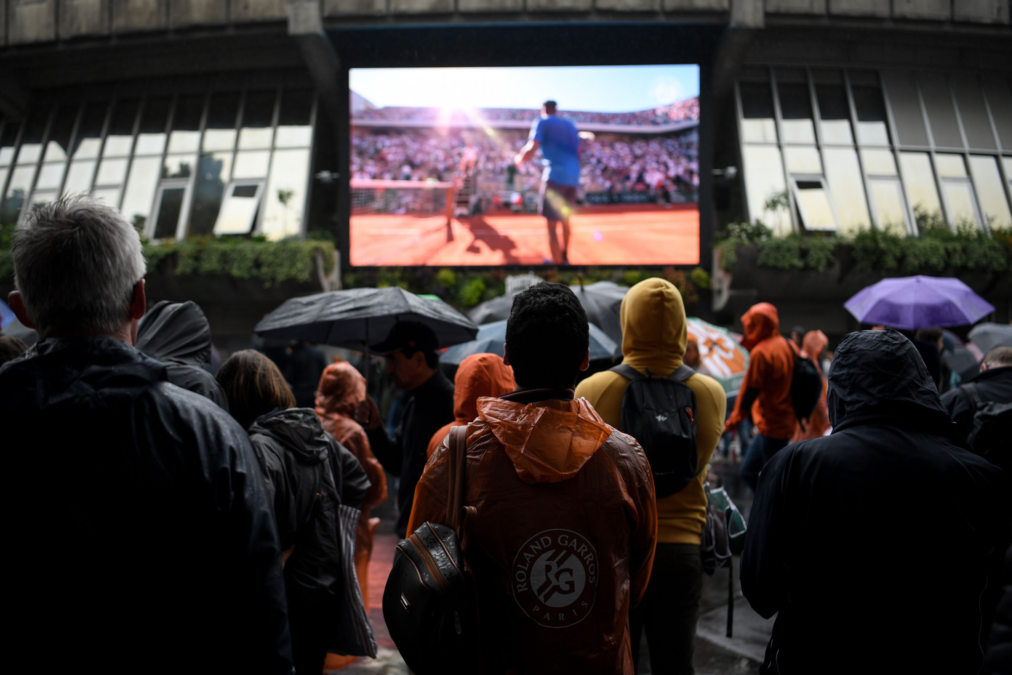 Fans had to settle for replays on the big screens as the rain poured on Roland Garros ©Getty Images