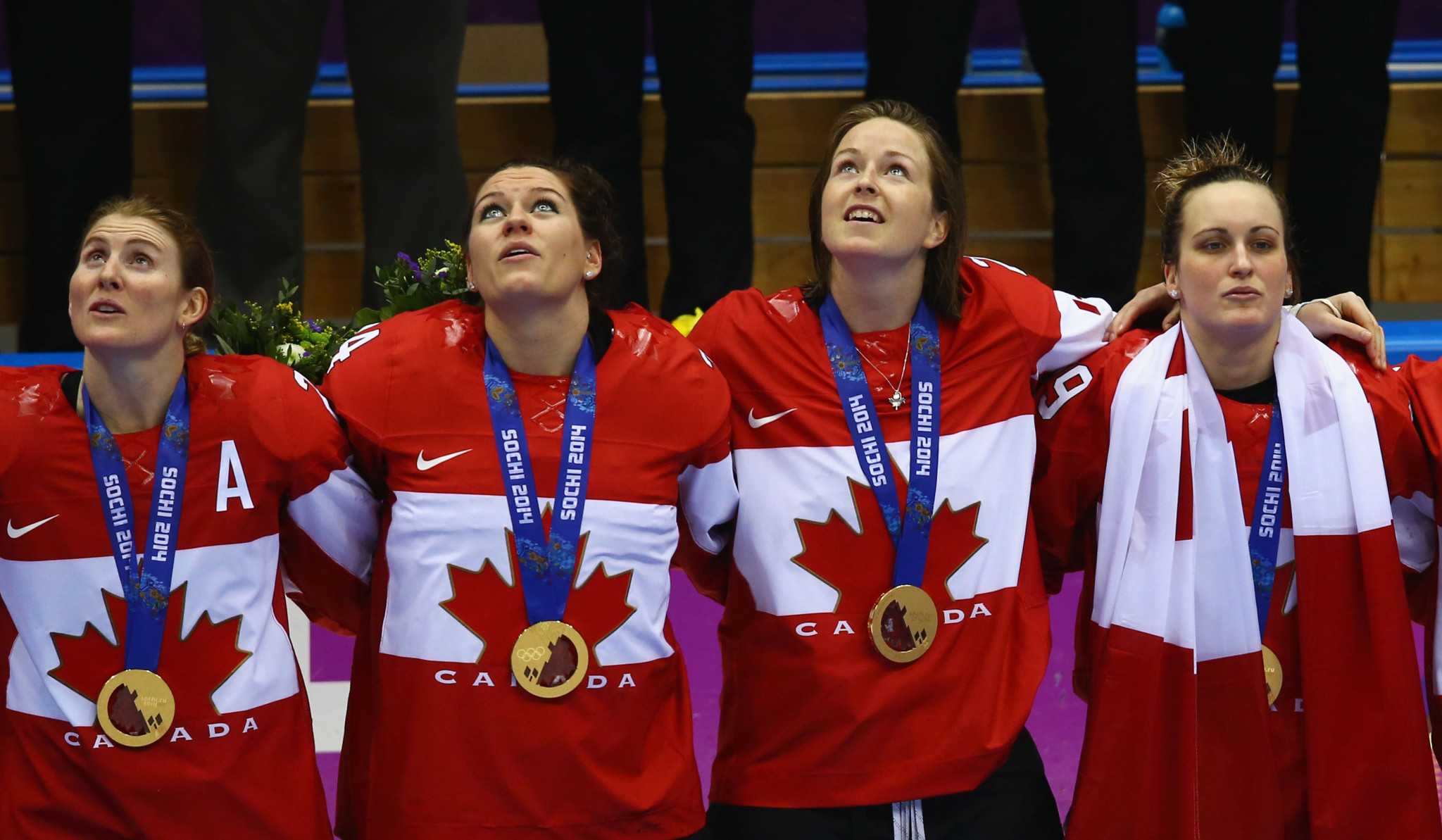 Canada's Hayley Wickenheiser, left, celebrates winning her fourth consecutive Olympic gold medal at Sochi 2014 ©Getty Images