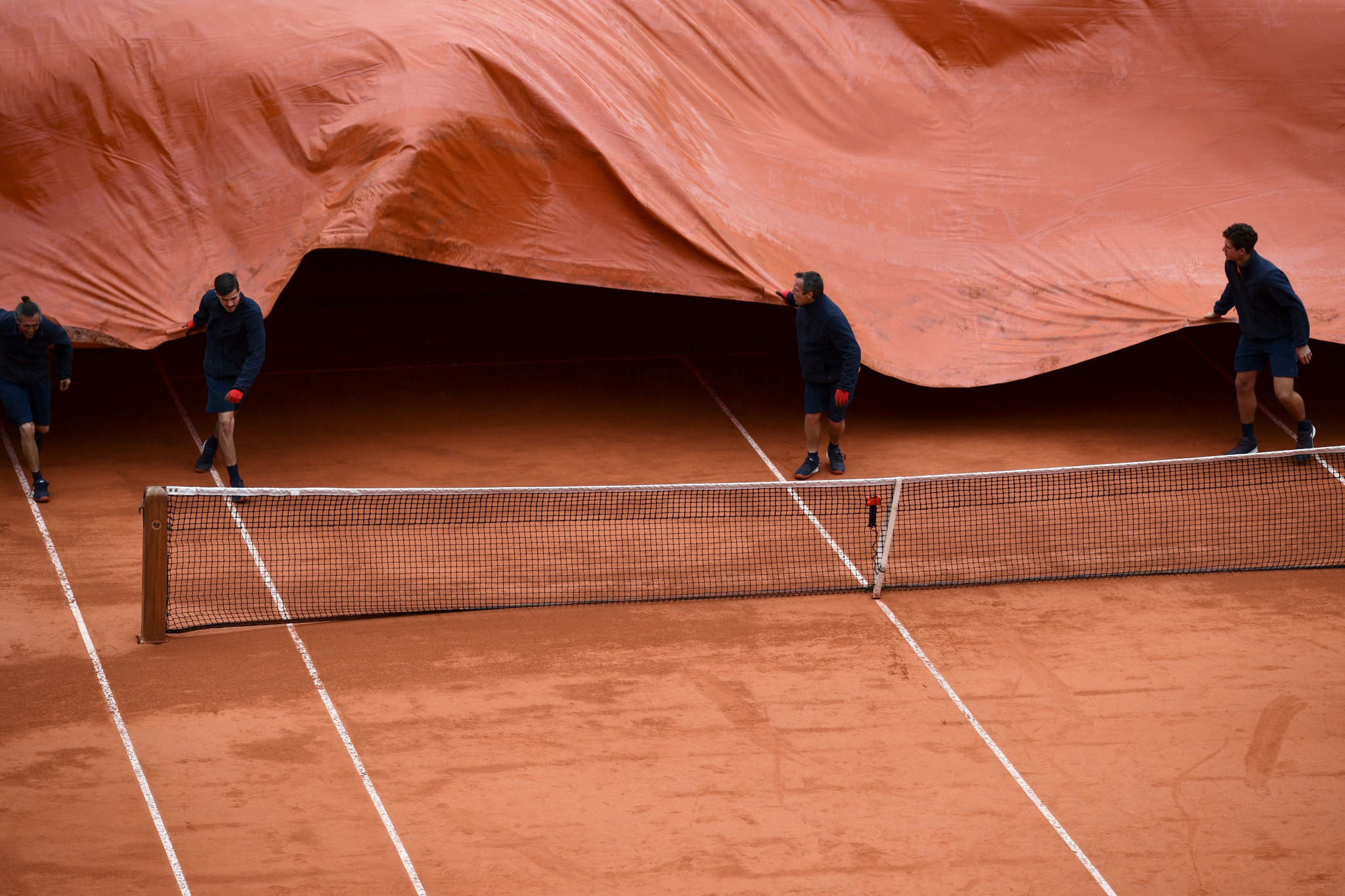 The Roland Garros covers were pulled out again on Friday as rain halted Serbian Novak Djokovic and Austrian Dominic Thiem's semi-final ©Getty Images
