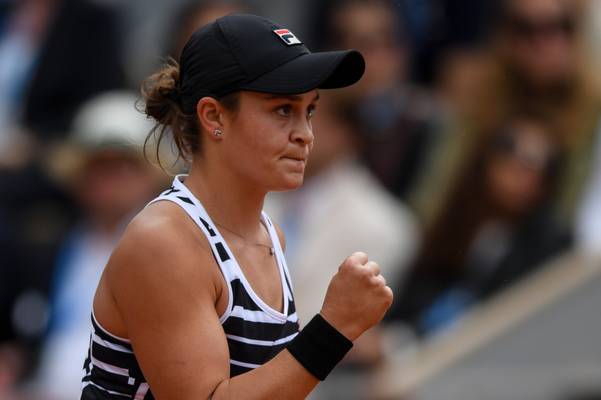 Eighth seed Barty pumps a fist after getting a crucial point in the women's French Open final ©Getty Images
