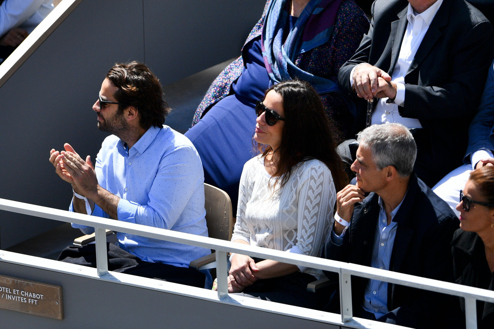 French actress Zoe Felix, centre, enjoys the men's French Open semi-final between Djokovic and Thiem ©Getty Images