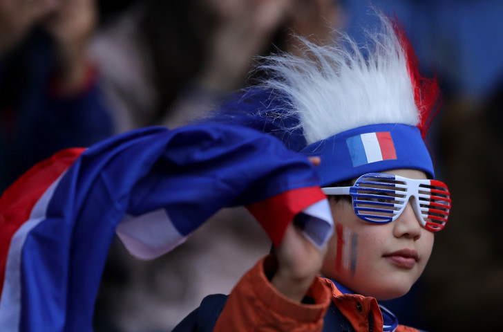 A young home fan watches Friday's opening match in the FIFA Women's World Cup 2019 between hosts France and South Korea ©Getty Images