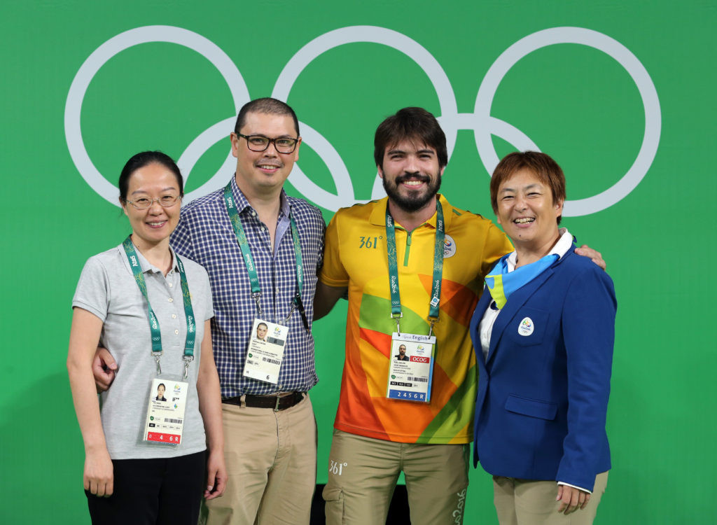 London 2012 weightlifting competition manager Matthew Curtain, second left, with, left to right, fellow weightlifting managers Yan Wang from Beijing 2008, Pedro Meloni Rio 2016 and Reiko Chinen Tokyo 2020 ©IWF