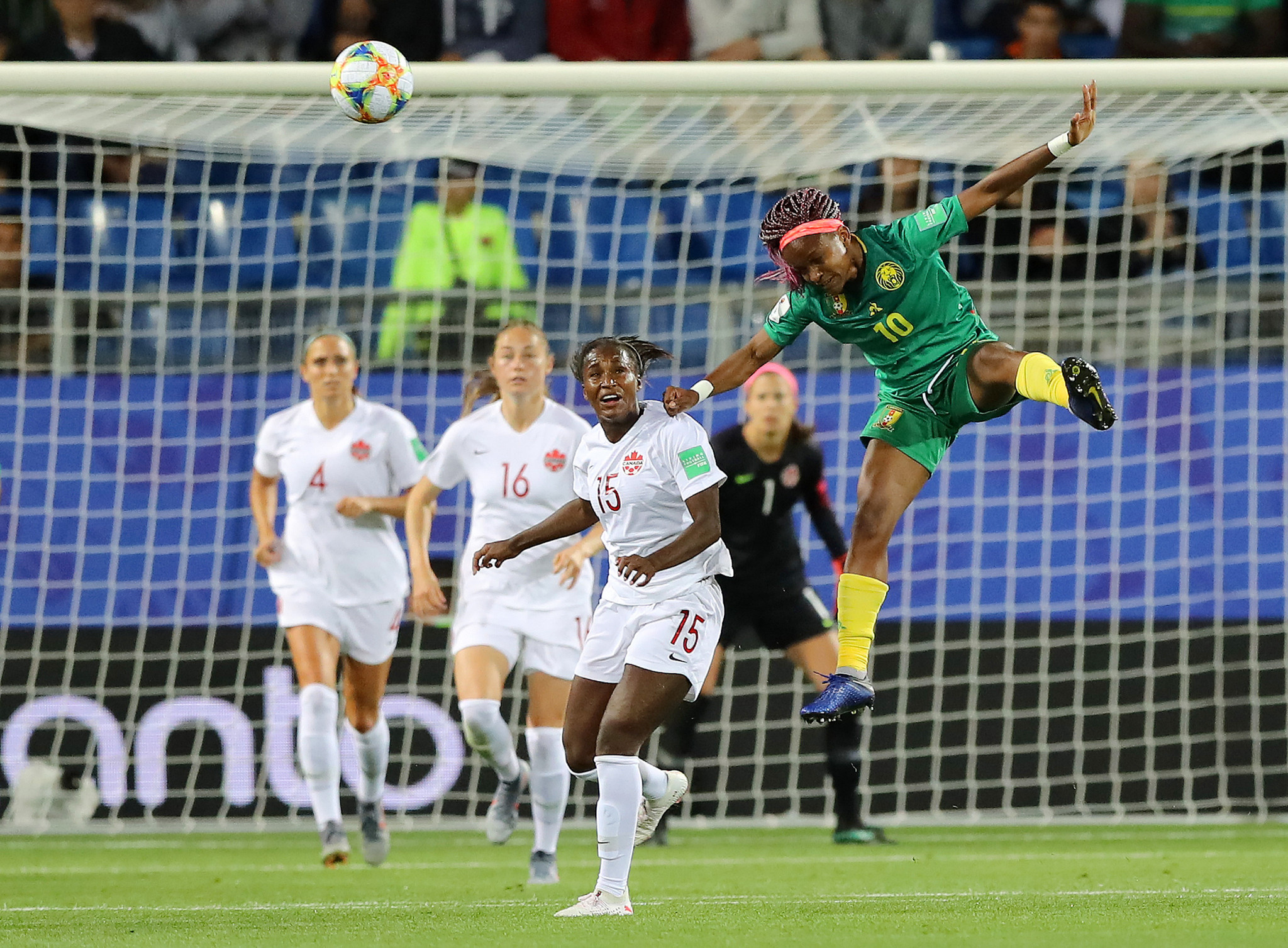 Jeannette Yango of Cameroon wins a header against Canada at Stade de la Mosson, Montpellier ©Getty Images
