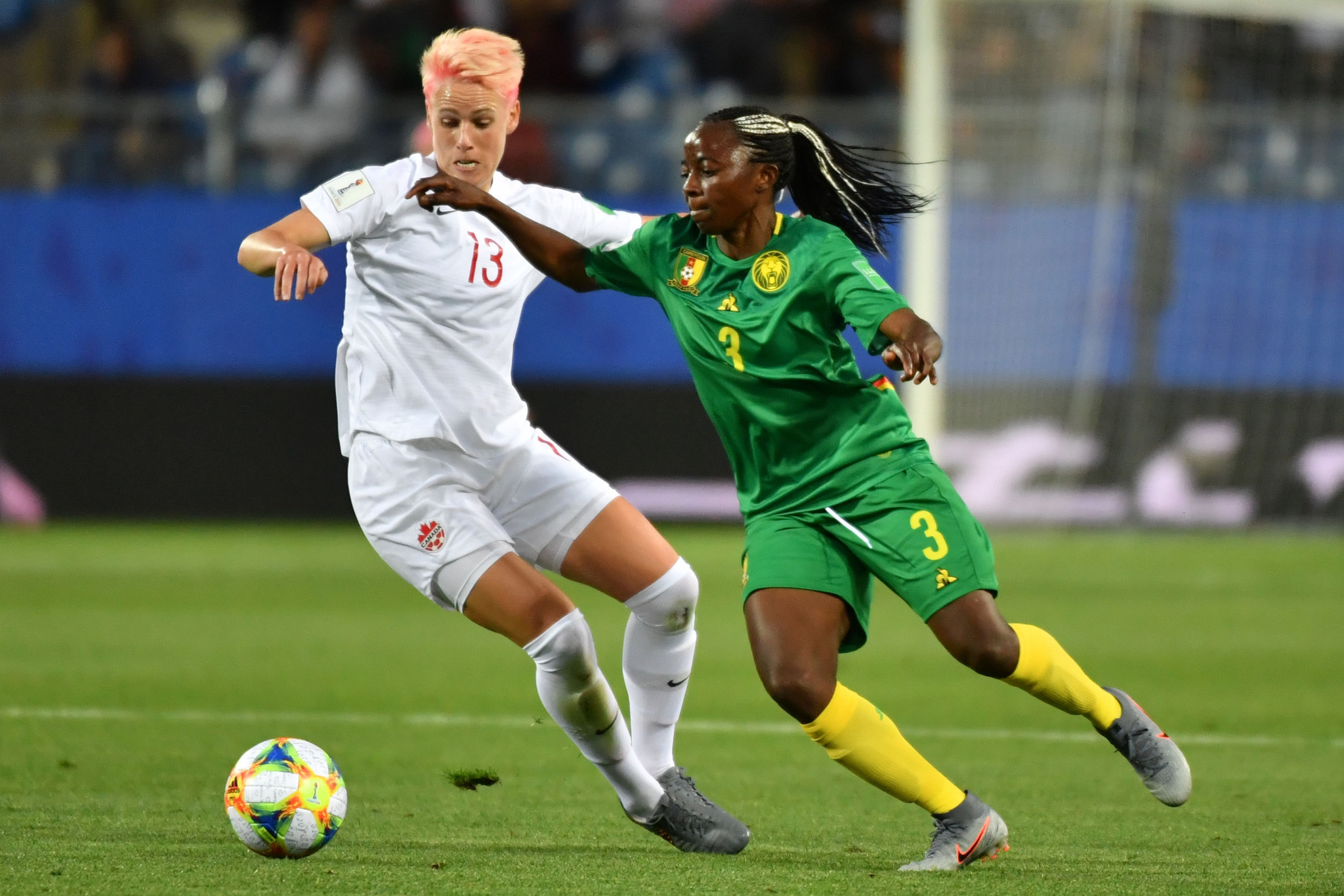 Canada midfielder Sophie Schmidt, left, jostles for possession with Cameroon forward Ajara Nchout ©Getty Images