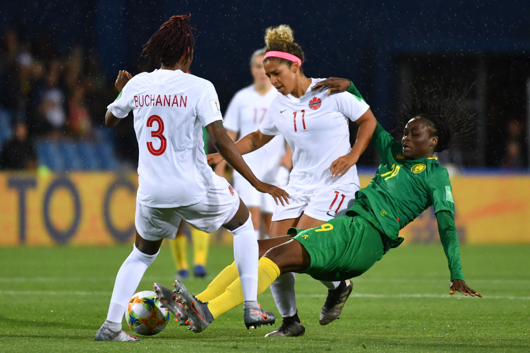 Kadeisha Buchanan of Canada goes in for a tackle on Cameroon's Marlyse Ngo Ndoumbouk ©Getty Images