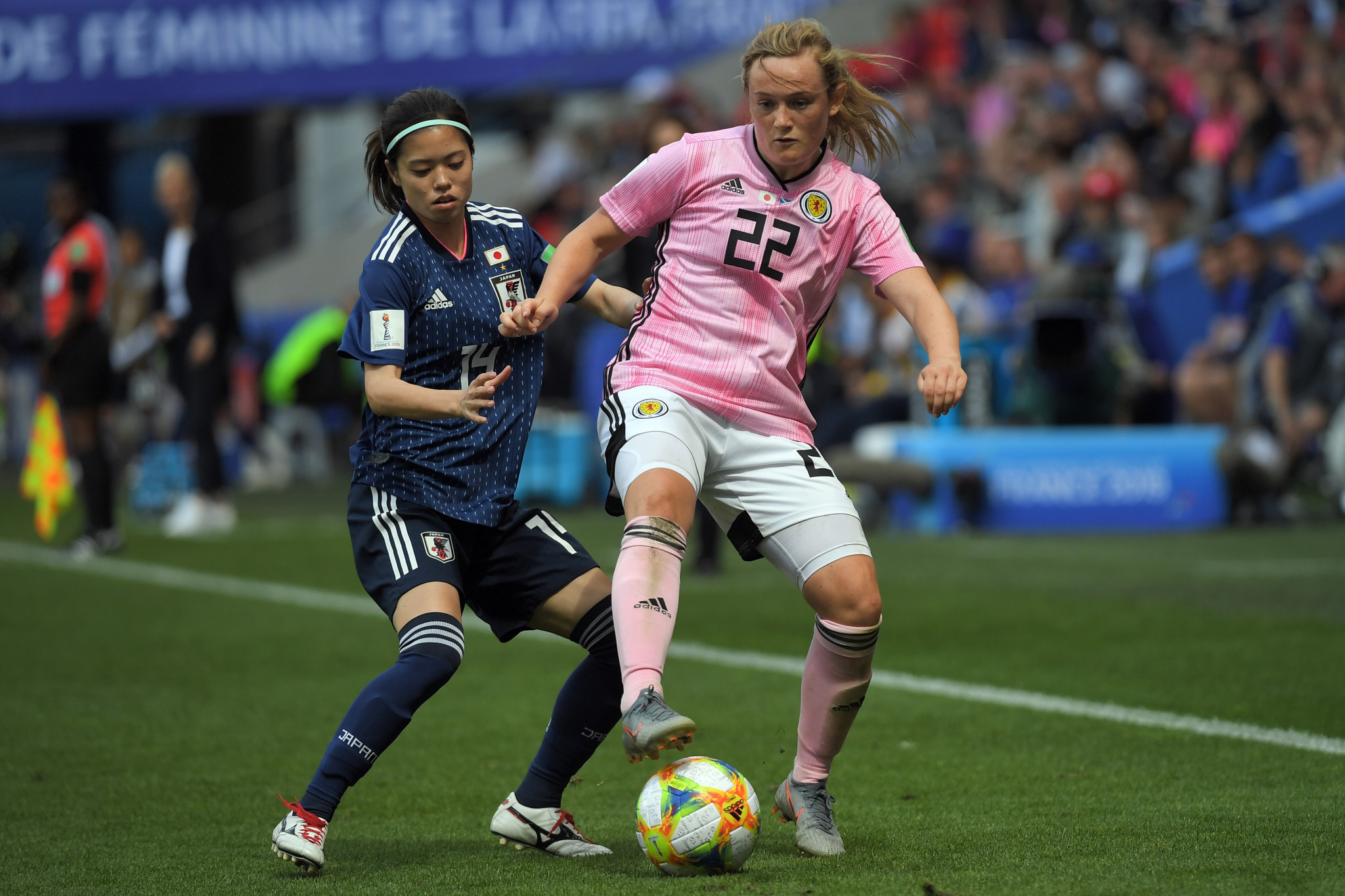 Japan midfielder Yui Hasegawa, left, battles for possession with Scottish forward Erin Cuthbert ©Getty Images