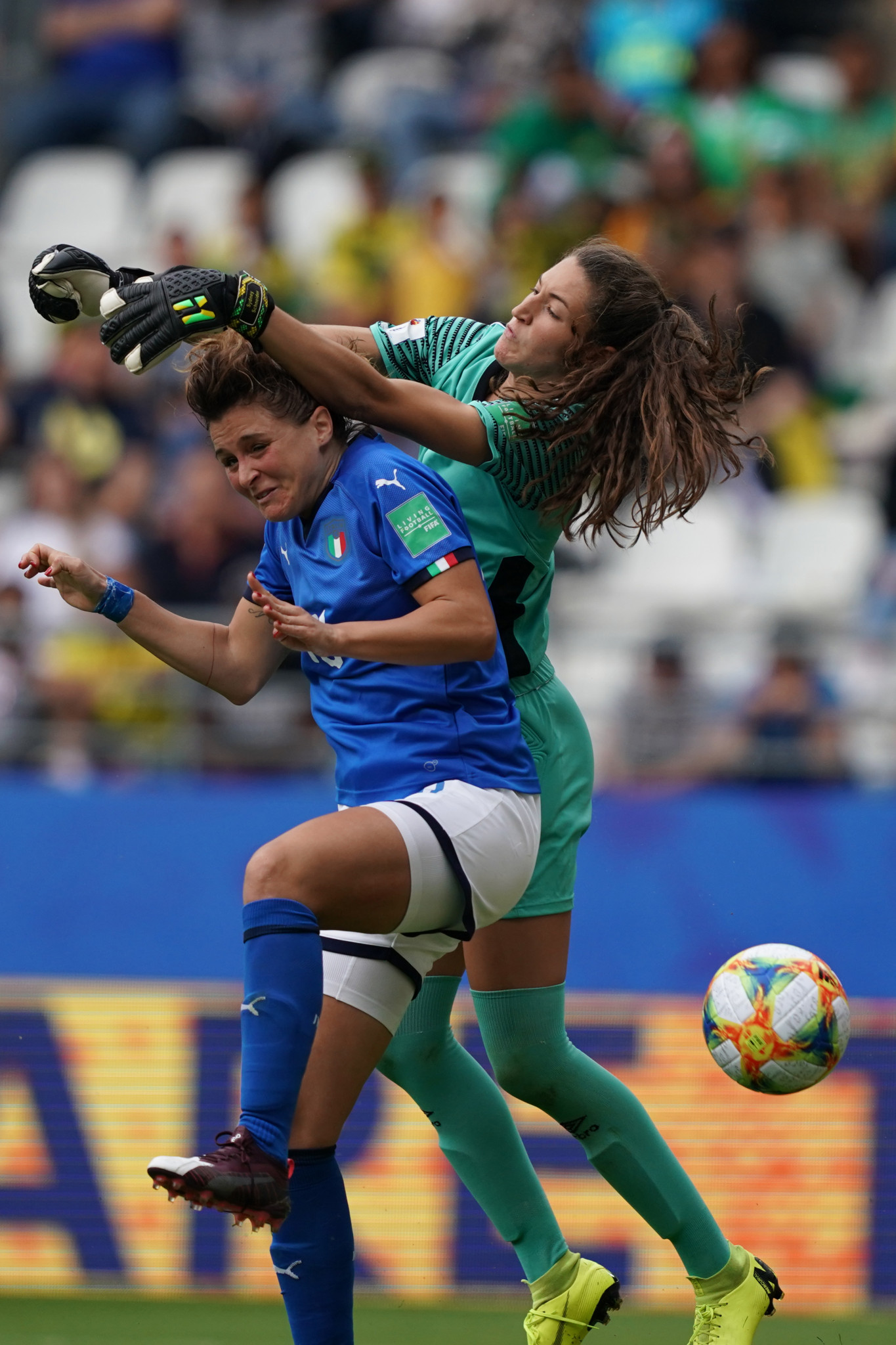Italy forward Cristiana Girelli, left, completes her hat-trick despite pressure from Jamaica goalkeeper Sydney Schneider ©Getty Images