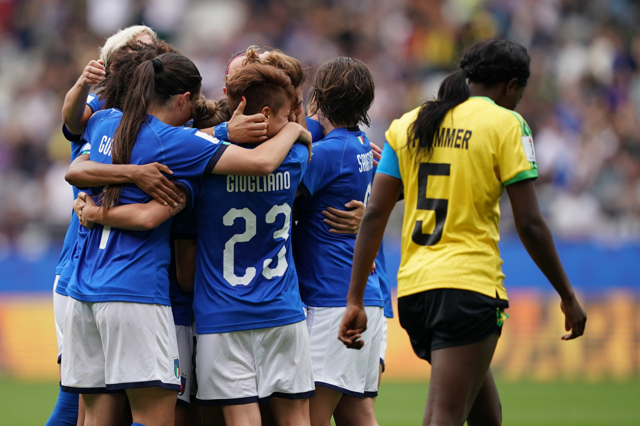 Cristiana Girelli is mobbed by her team mates after putting Italy 3-0 up against Jamaica ©Getty Images