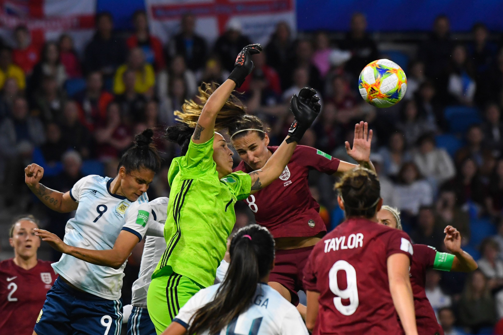 Argentina goalkeeper Vanina Correa, centre, cuts out a cross in a Group D match against England ©Getty Images