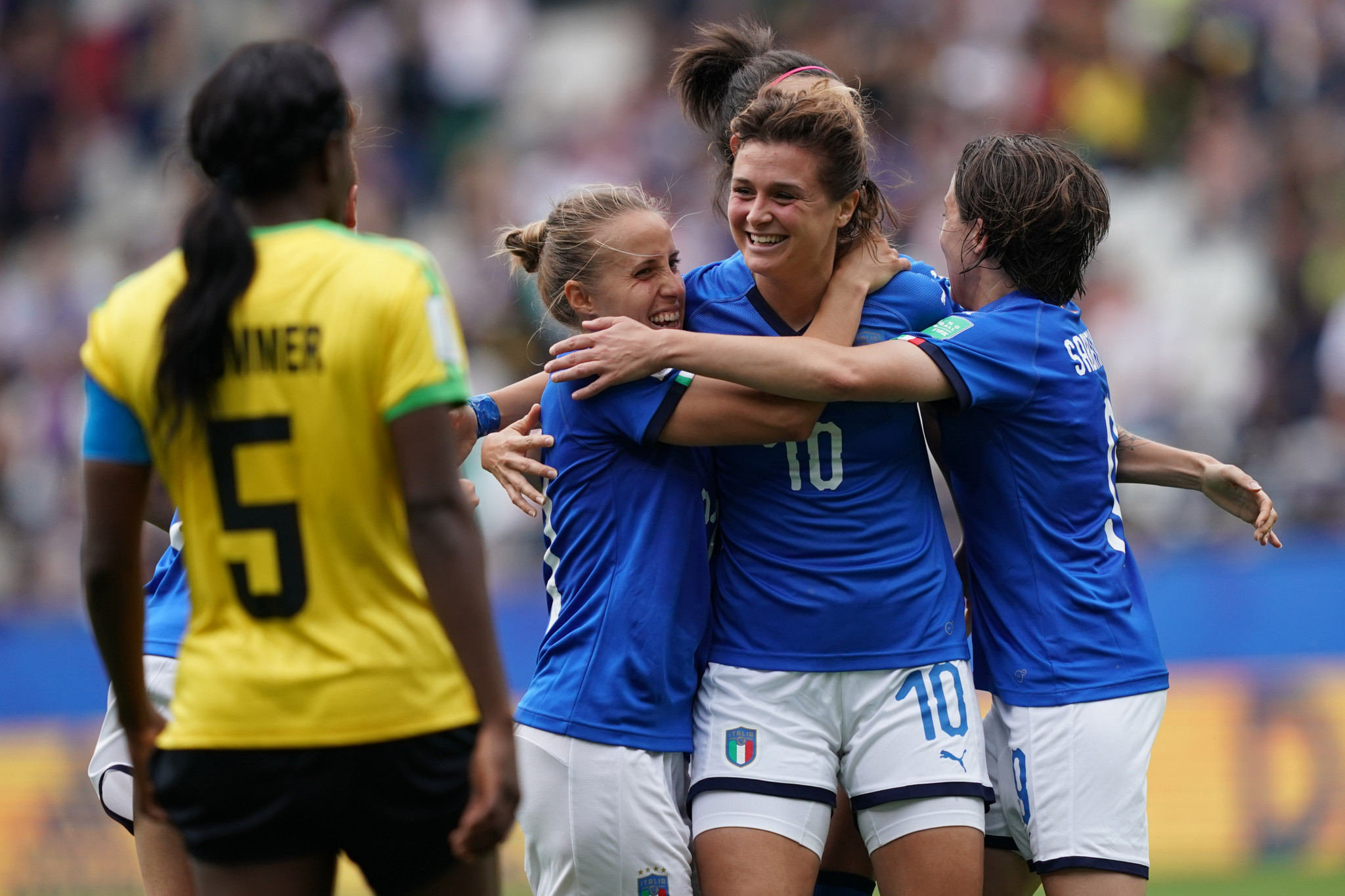 Italy striker Cristiana Girelli, centre, is embraced by her team mates after completing her hat-trick against Jamaica ©Getty Images