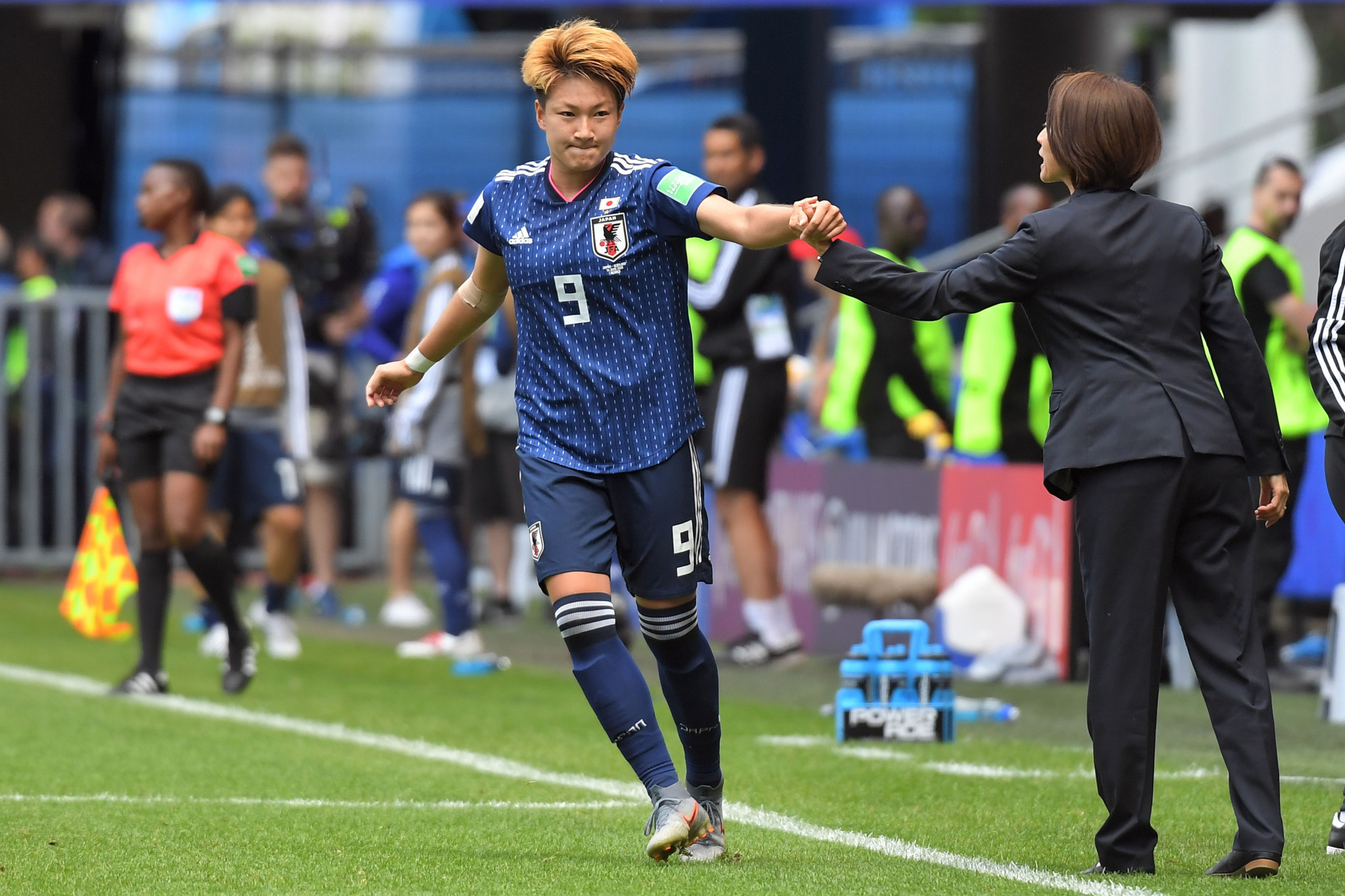 Japan forward Yuika Sugasawa, left, is congratulated by her coach Asako Takakura after doubling Japan's lead against Scotland ©Getty Images