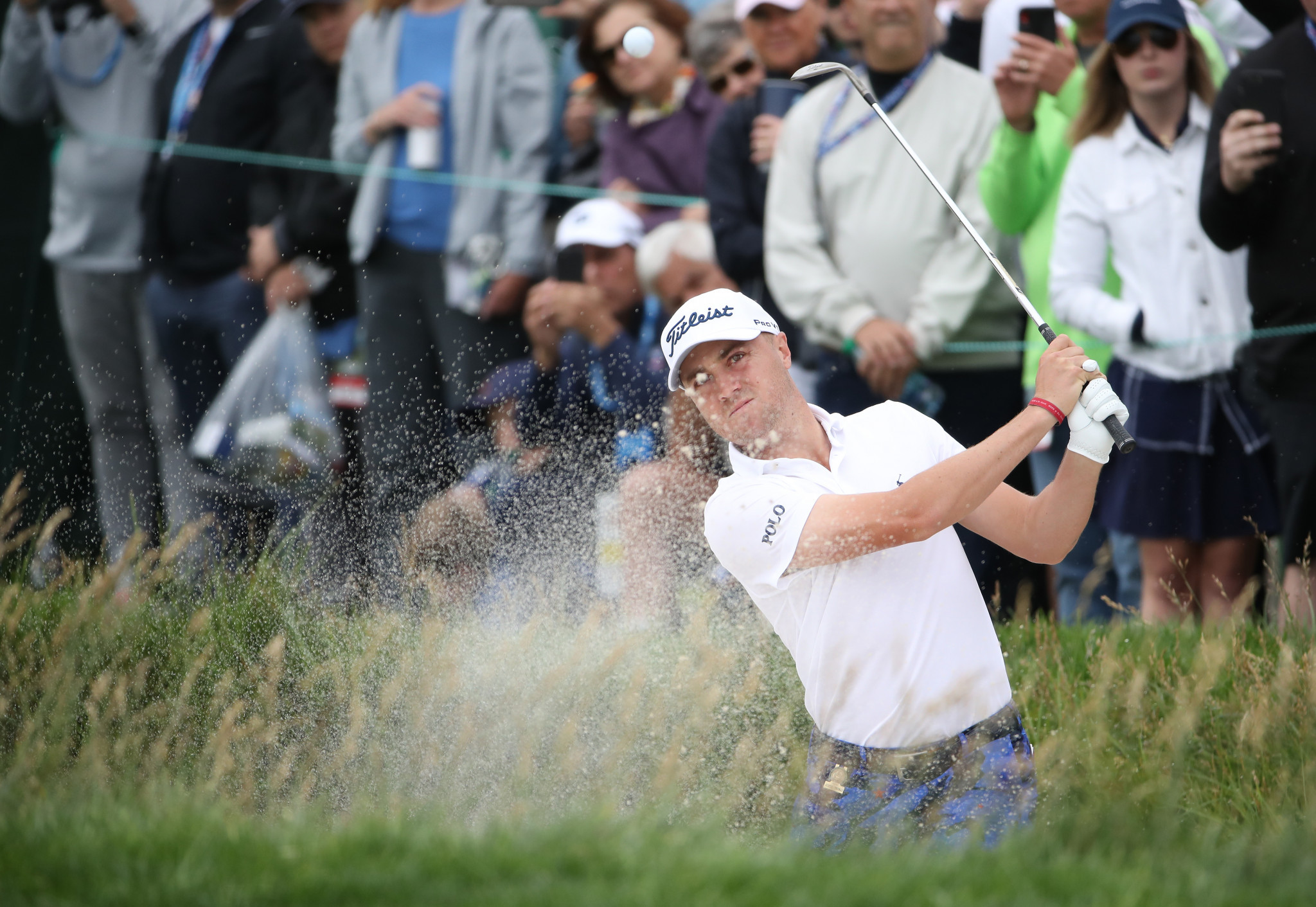 Justin Thomas of the United States plays a bunker shot at Pebble Beach Golf Links ©Getty Images