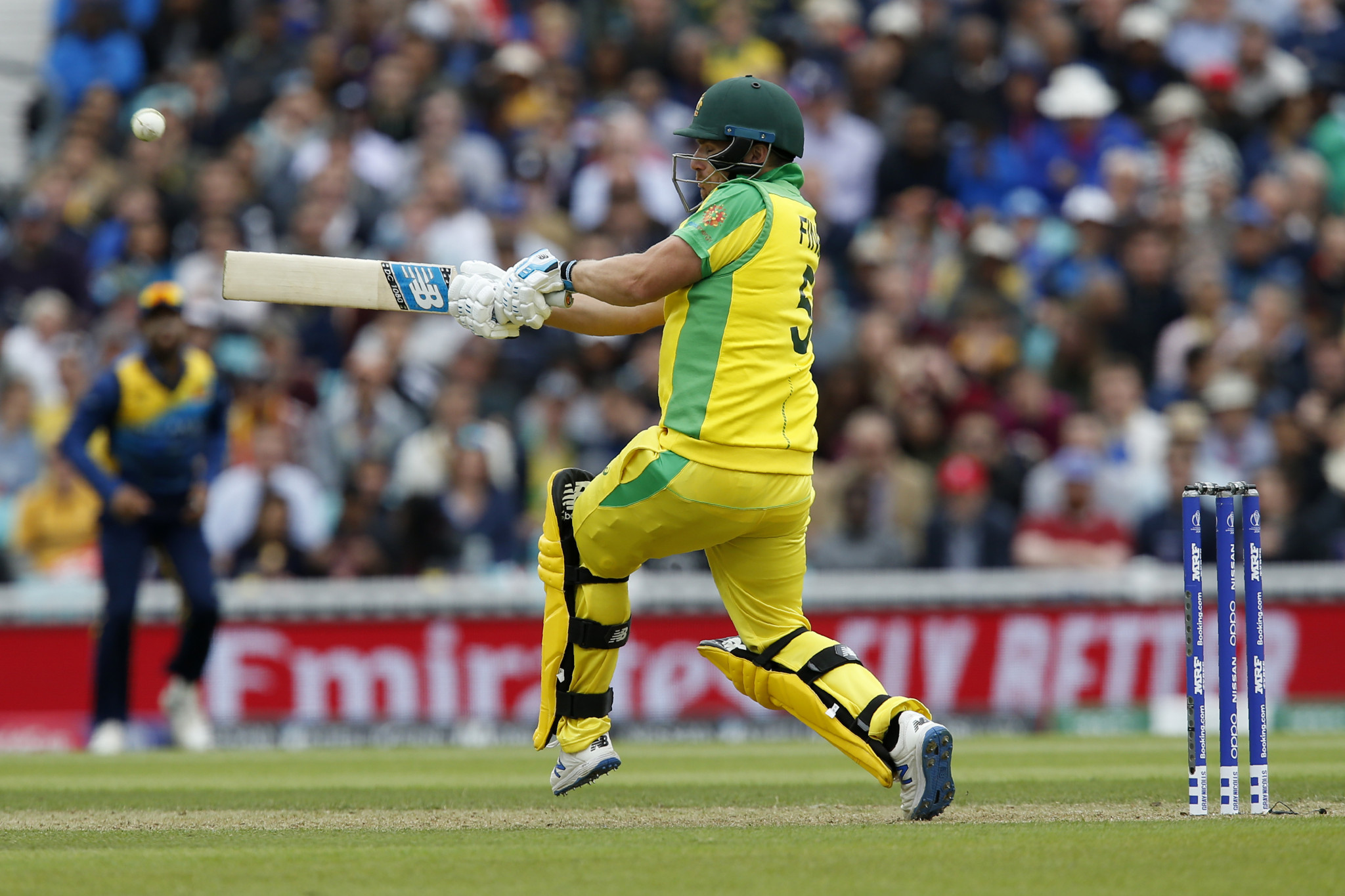 Finch and Starc guide defending champions Australia to victory over Sri Lanka at Cricket World Cup